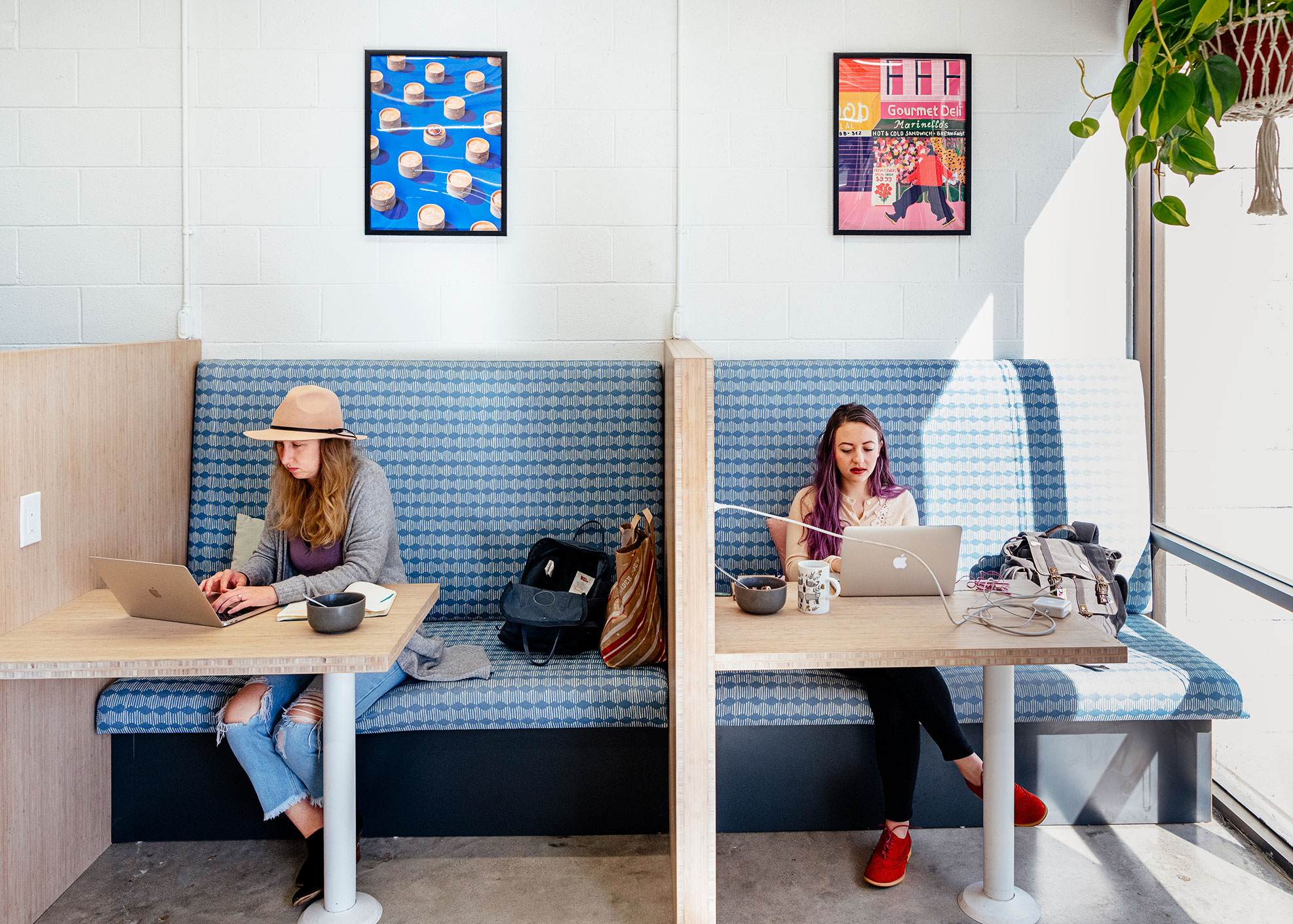 Leanne Robinson, left, and Shea Costales at Column Five on Jan. 23. The firm is trying new ways to help employees be productive while working at home.
