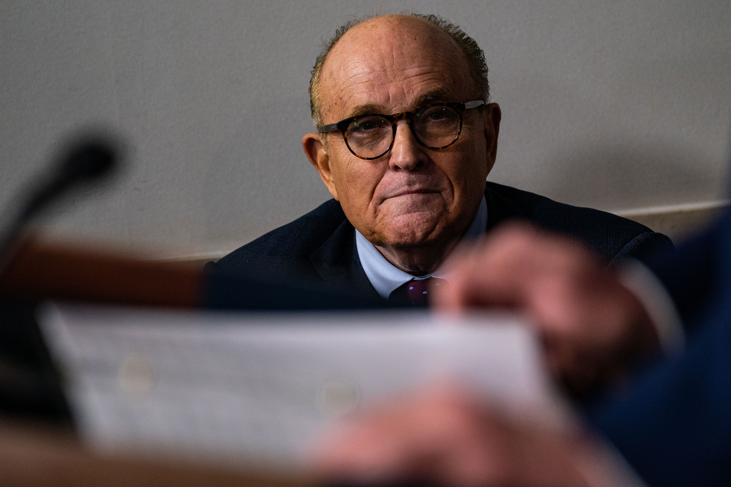 Rudy Giuliani listens as President Trump speaks during a news briefing at the White House in Washington, D.C., on Sept. 27, 2020.