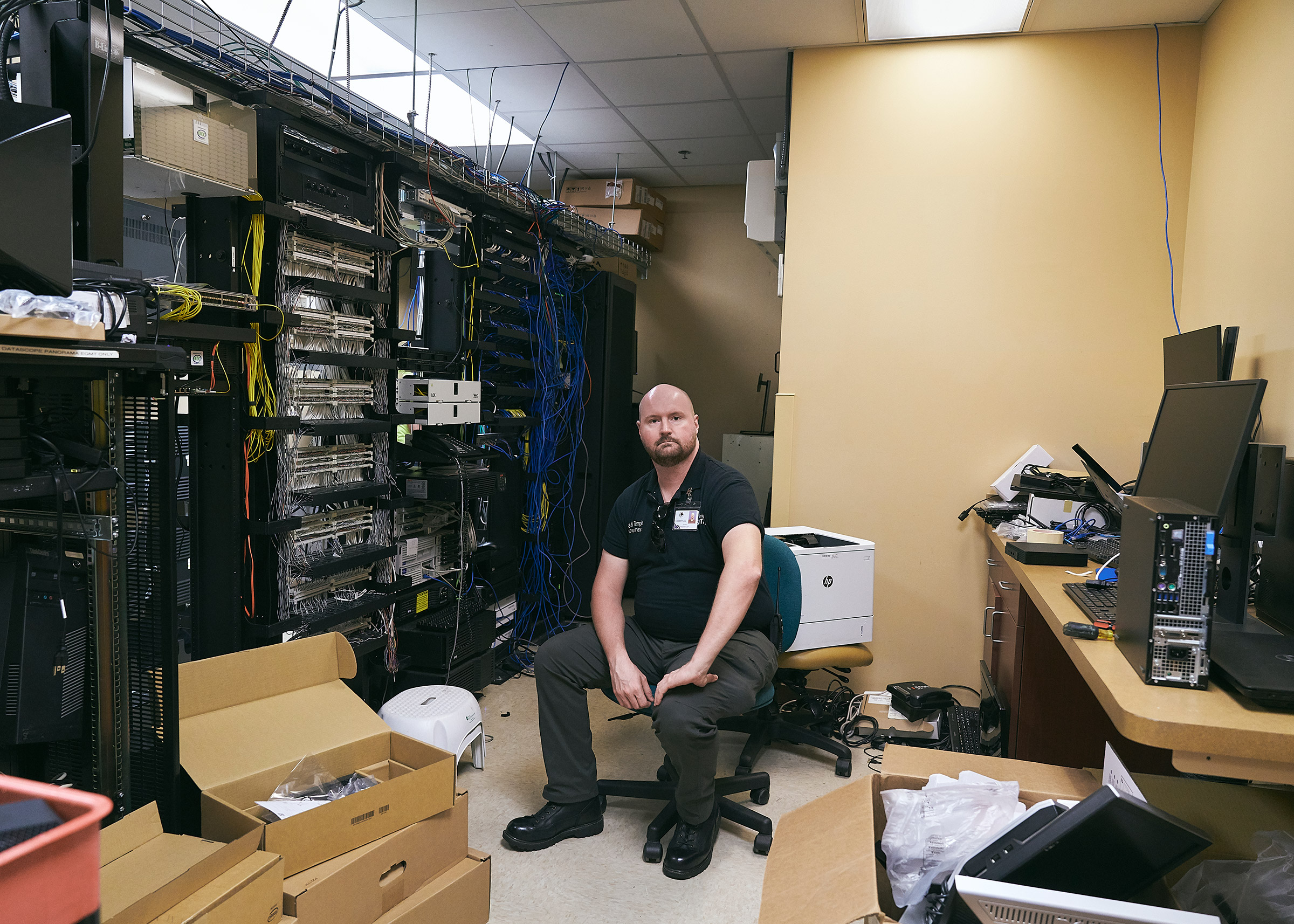 Facilities assistant James Temple in the newly upgraded computer systems center at Clinch Memorial Hospital.