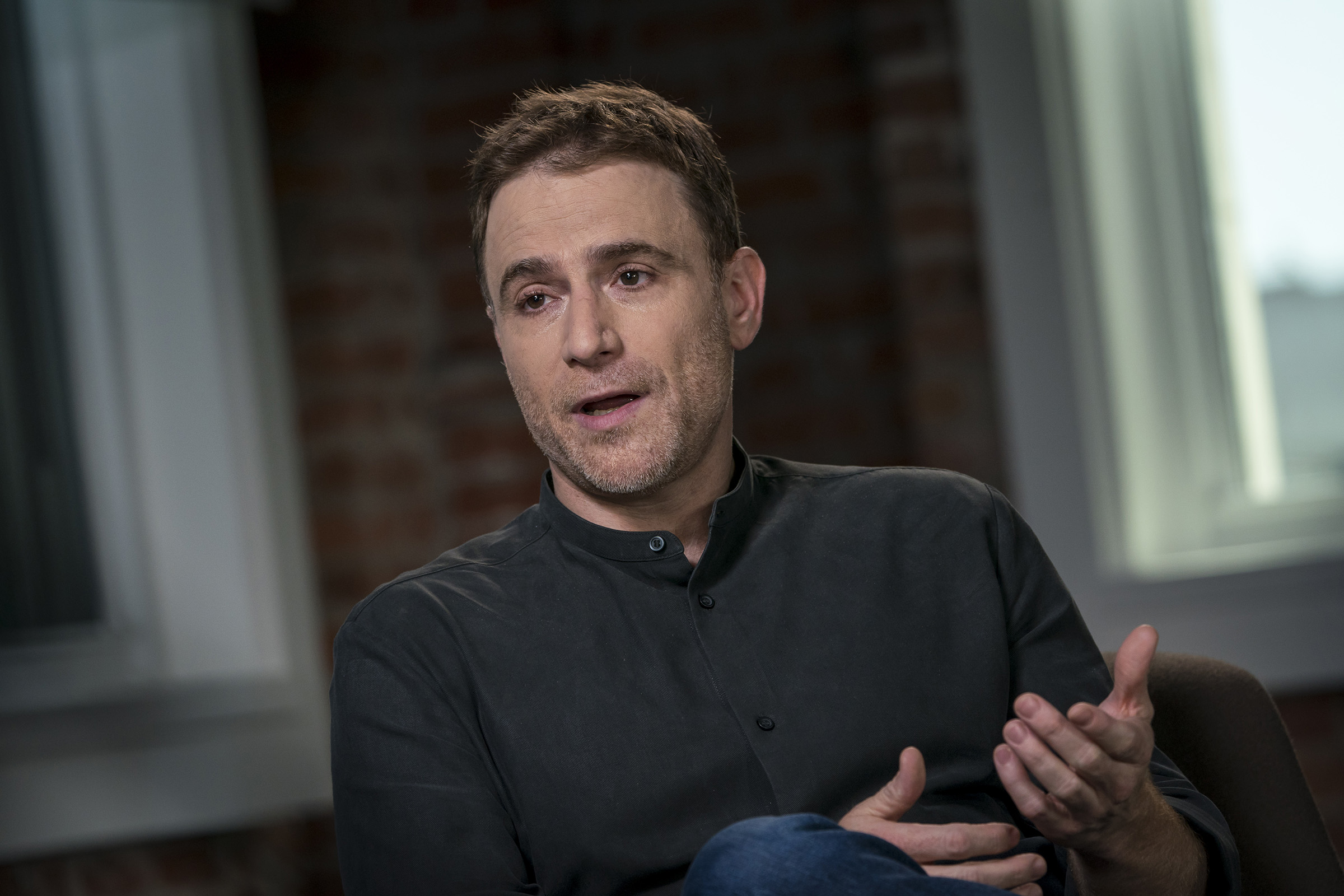 Stewart Butterfield, co-founder and chief executive officer of Slack Technologies Inc., speaks during a television interview in San Francisco on Aug. 3, 2018.