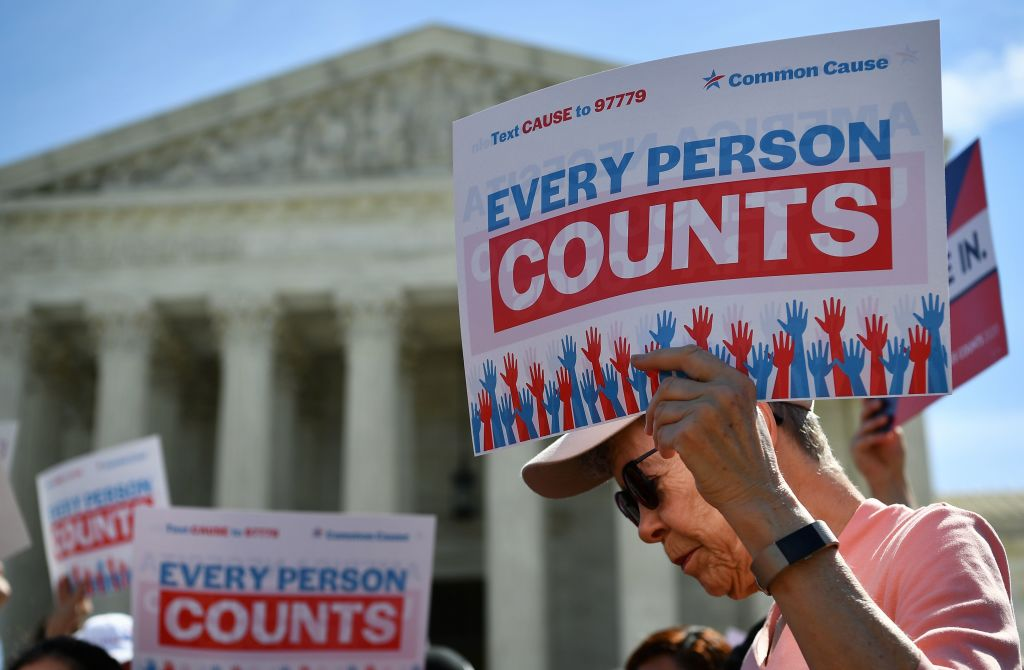 Demonstrators protest a proposal to add a citizenship question to the 2020 census at the Supreme Court in Washington, DC, on April 23, 2019.