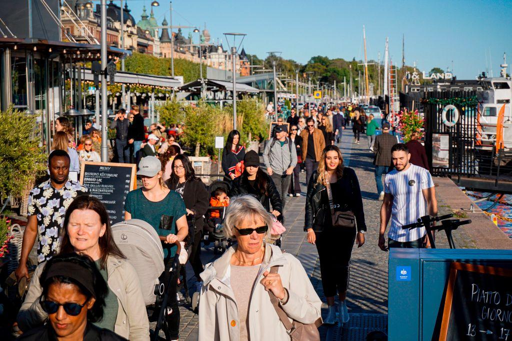 People walk on Stranvagen in Stockholm on Sept. 19, 2020.