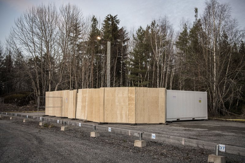 Refrigeration containers to be used on standby as makeshift morgues to store people who have died from COVID-19 set up behind Karolinska University Hospital in Huddinge, Sweden on March 26, 2020.