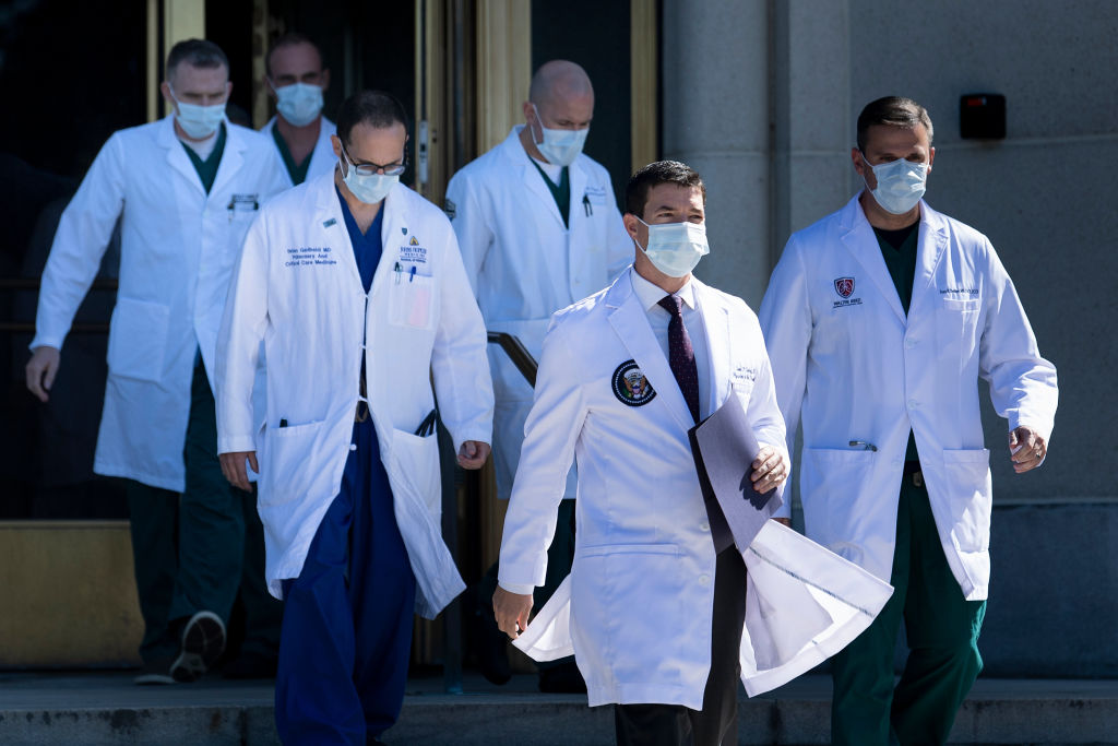 White House physician Sean Conley (2nd R), with medical staff, arrives to give an update on the condition of U.S. President Donald Trump, on October 3, 2020, at Walter Reed Medical Center in Bethesda, Maryland.