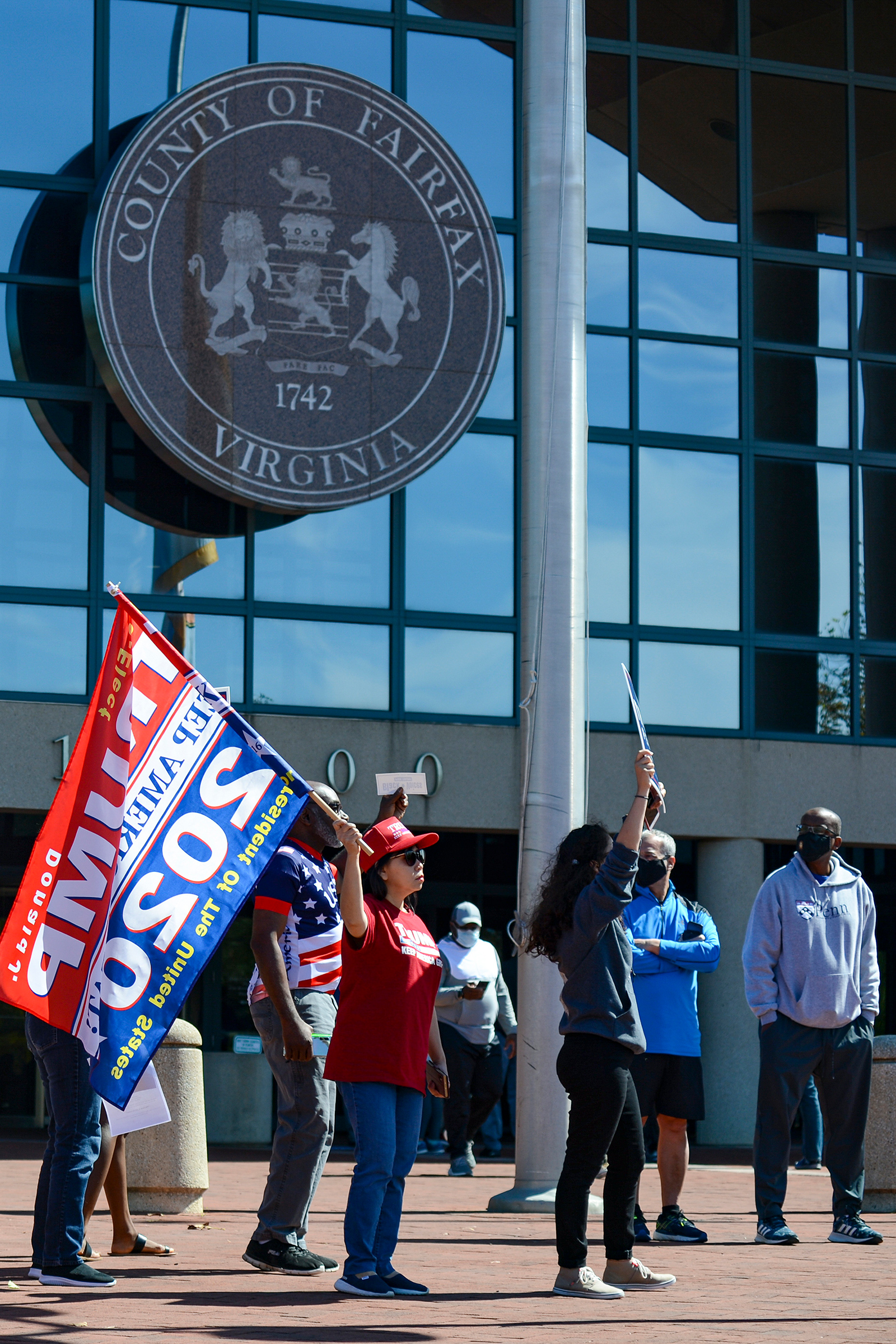 "Trump supporters chant, ""Four more years,"" on Sept. 19 outside the Fairfax County Government Center in Fairfax, Va., disrupting early voting"