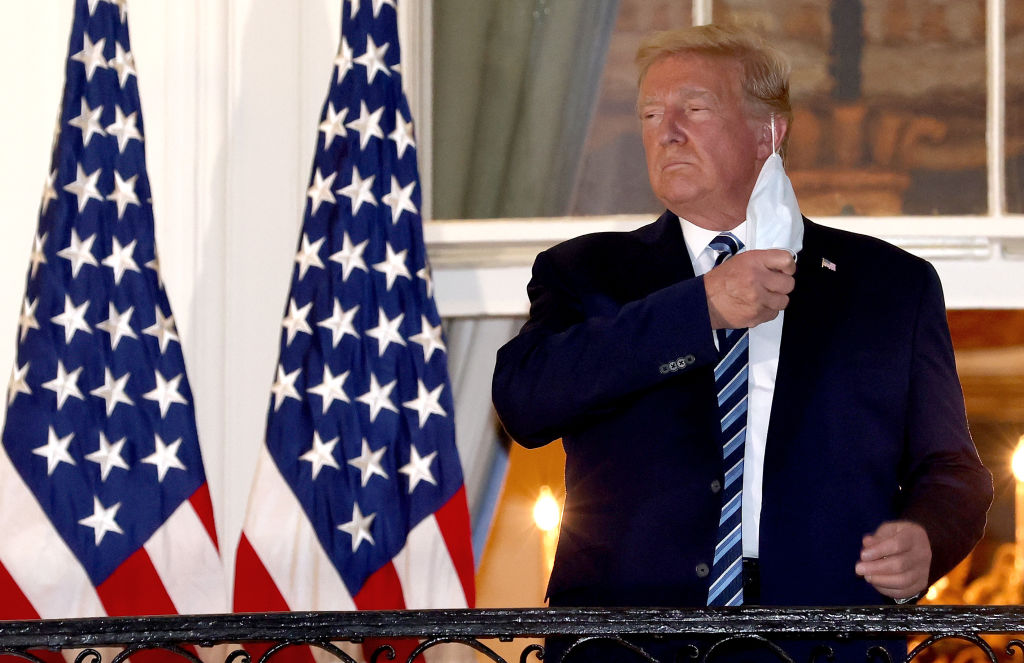 President Donald Trump removes his mask upon return to the White House from Walter Reed National Military Medical Center on October 05, 2020 in Washington, DC. Trump spent three days hospitalized for coronavirus.