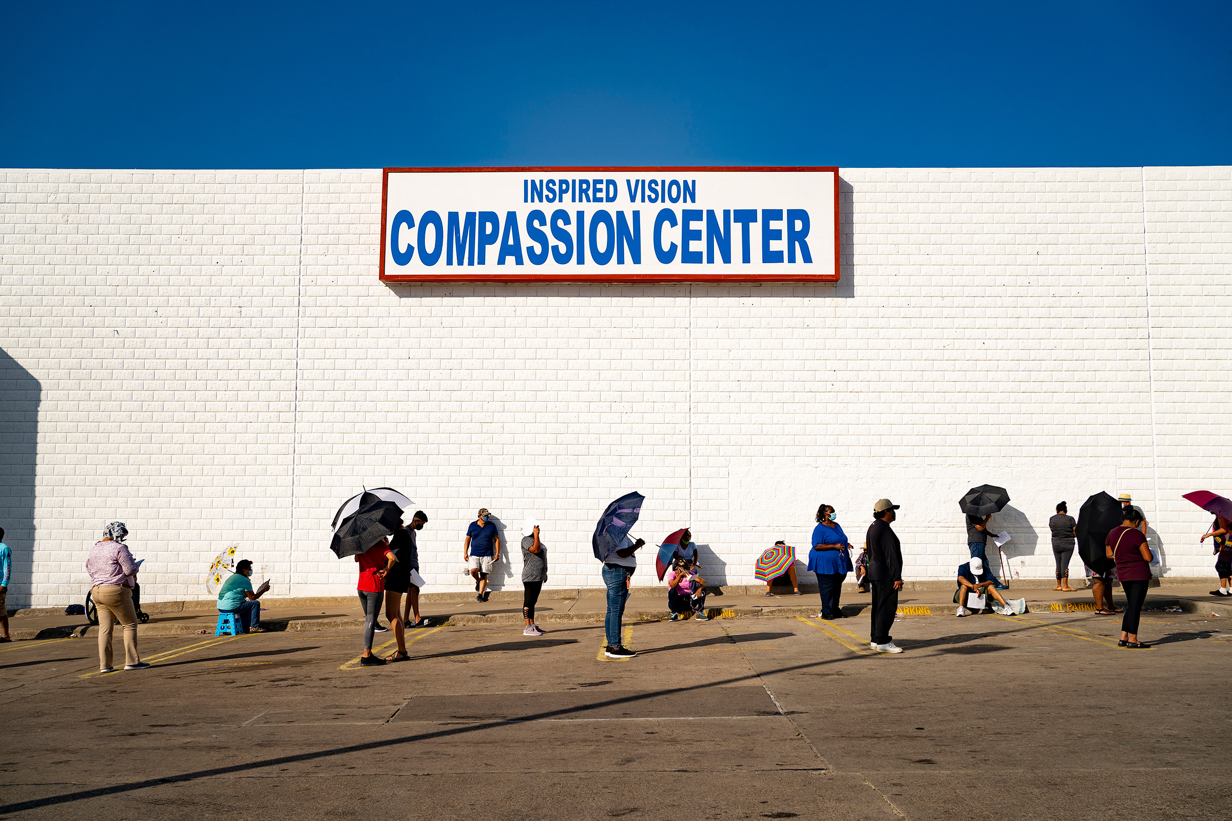 People line up at the Inspired Vision & Compassion Center food bank in Dallas on Aug. 14
