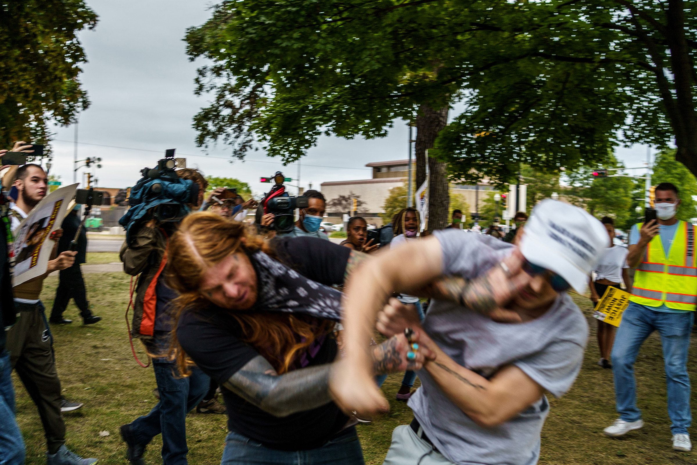 A protester scuffles with a Trump supporter (R) in Kenosha, Wis. on Sept. 1 amid ongoing demonstrations after the shooting by police of Jacob Blake
