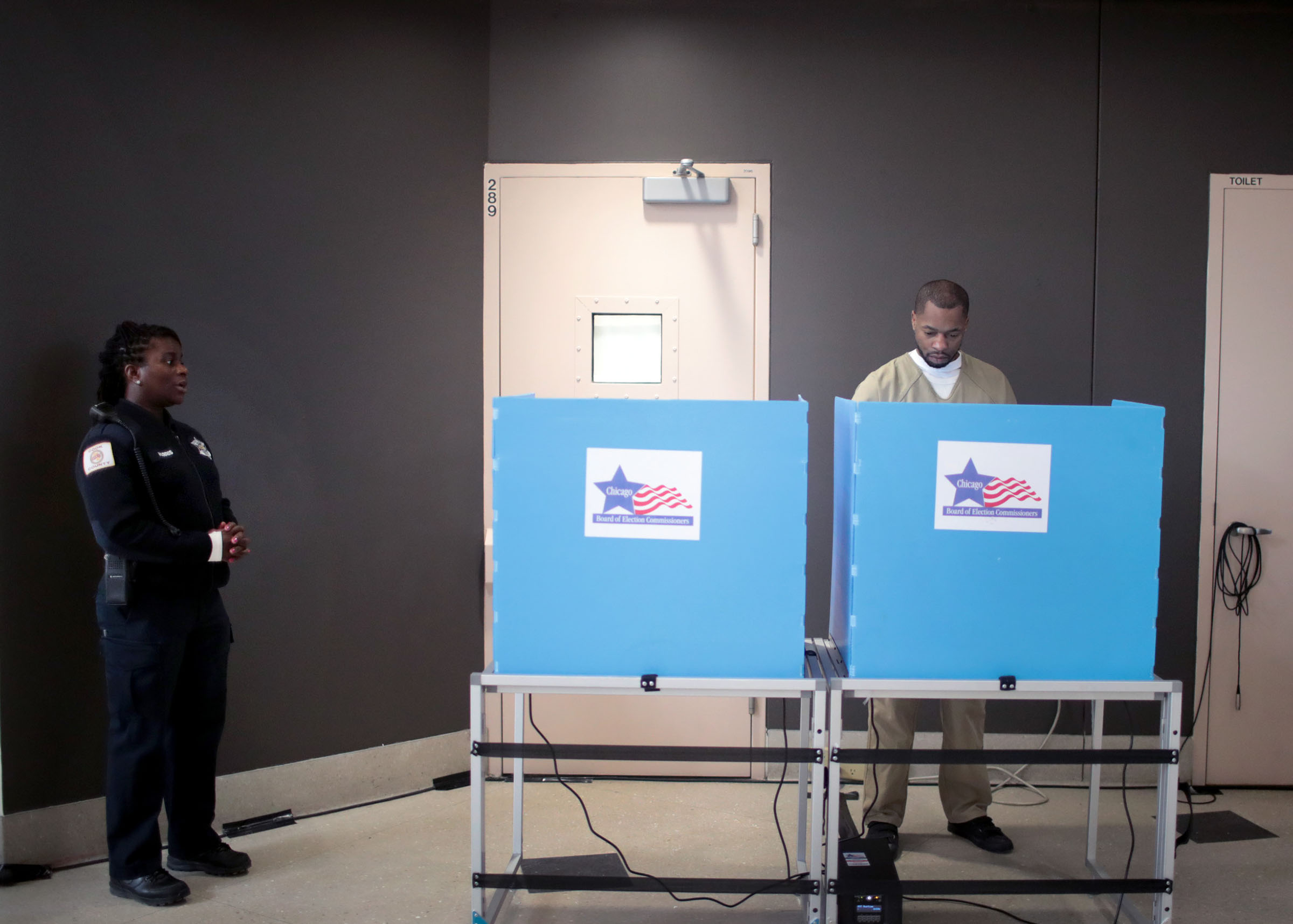 An inmate at the Cook County Jail votes in the Illinois primary election in Chicago on March 7, 2020.
