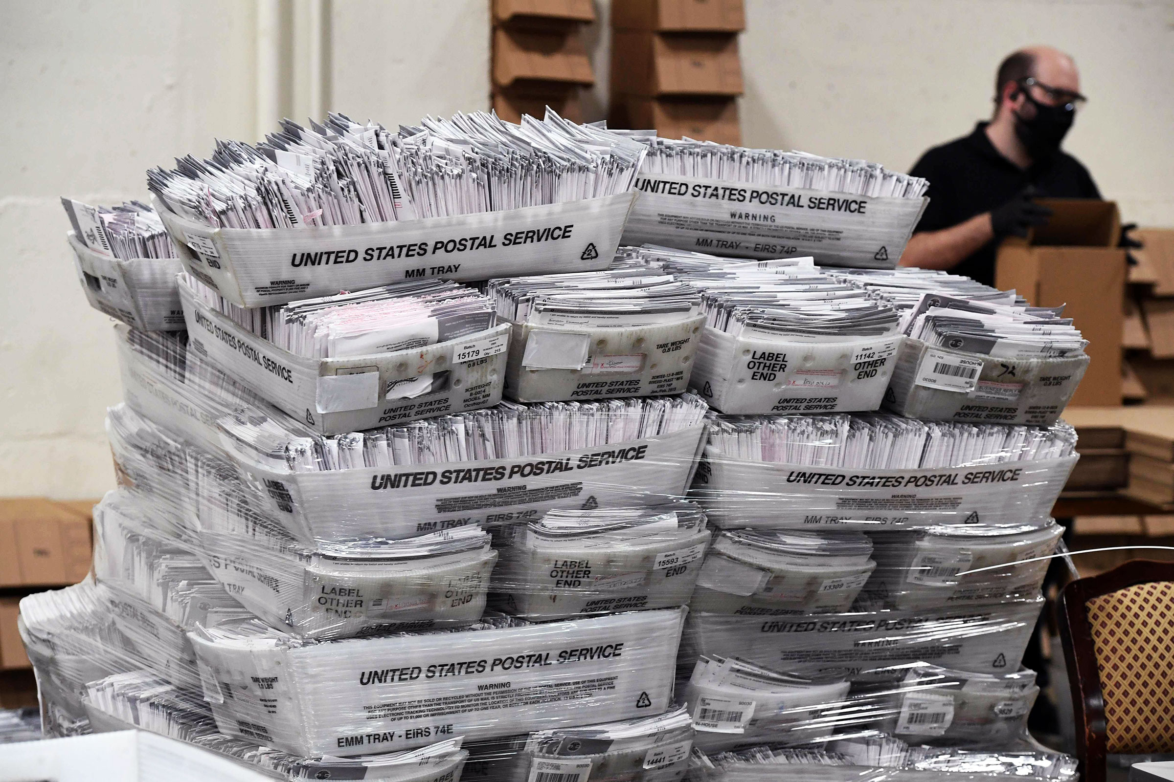 Mail-in ballots in their envelopes await processing at the Los Angeles County Registrar Recorders' mail-in ballot processing center in Pomona, Calif., On Oct. 28, 2020.
