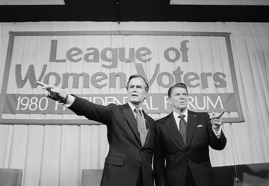 George Bush (L) and Ronald Reagan before the start of a debate before the League of Women Voters Forum in Houston in April 1980