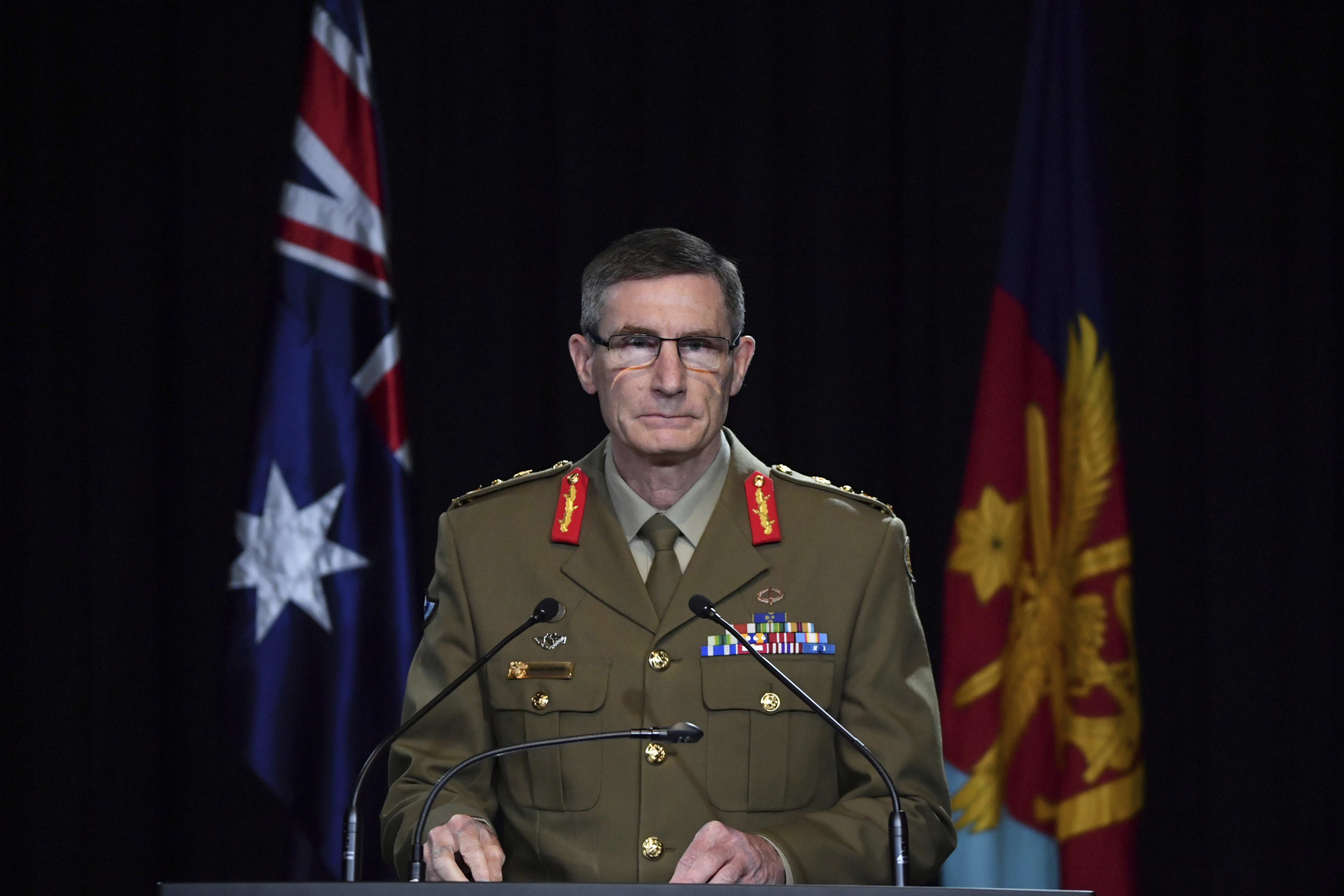 Chief of the Australian Defence Force Gen. Angus Campbell delivers the findings from the Inspector-General of the Australian Defence Force Afghanistan Inquiry, in Canberra, Thursday, Nov. 19, 2020.