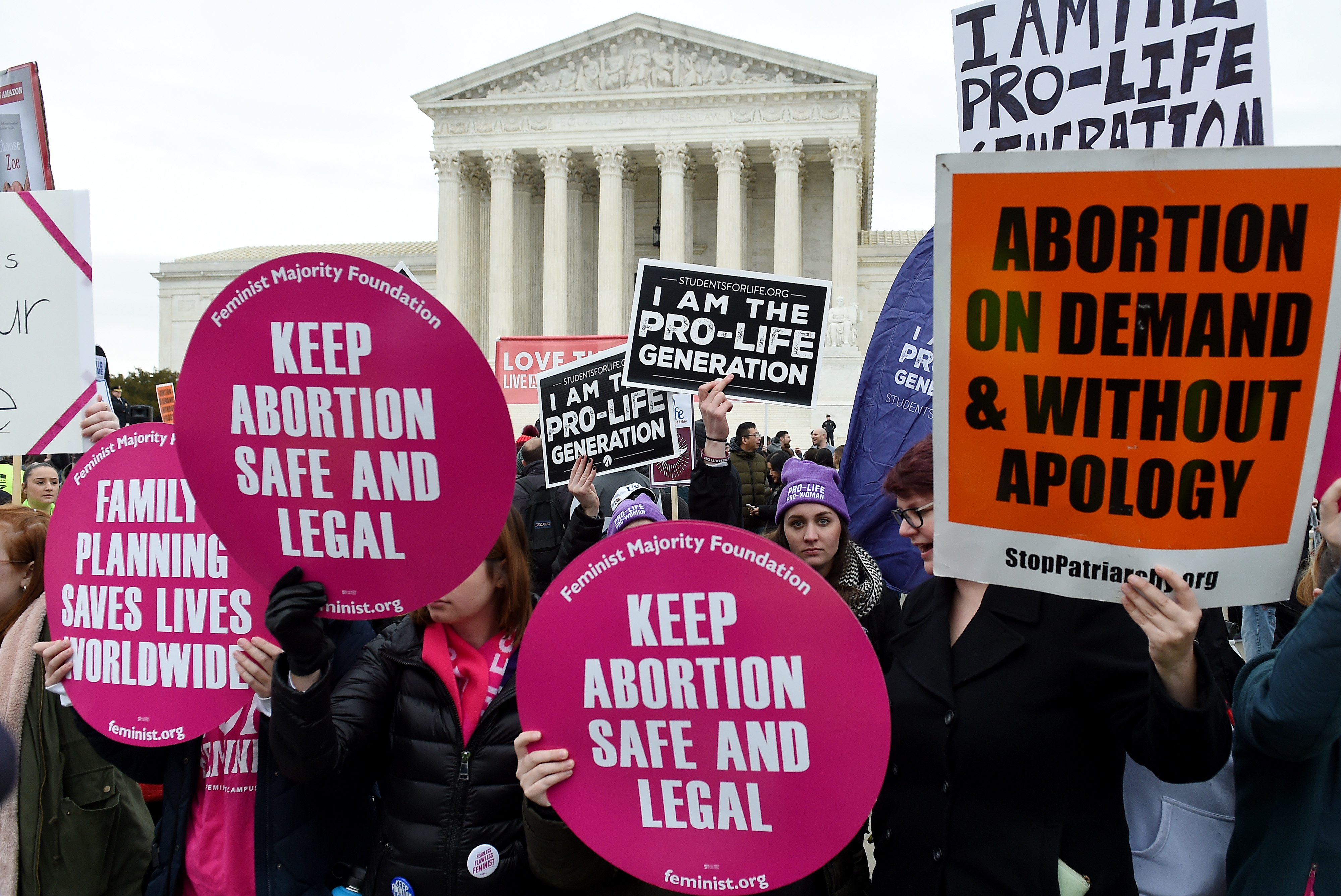 Abortion rights supporters and anti-abortion advocates demonstrate in front of the the Supreme Court during the 47th annual March for Life on Jan. 24 in Washington, D.C.  in decades on the controversial subject of abortion.