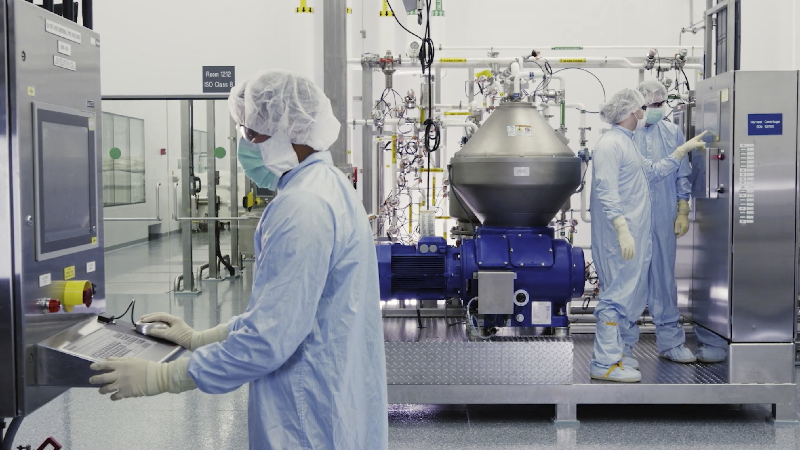 Scientists work with a bioreactor at a company facility in New York state for efforts on an experimental coronavirus antibody drug on Oct. 2, 2020.