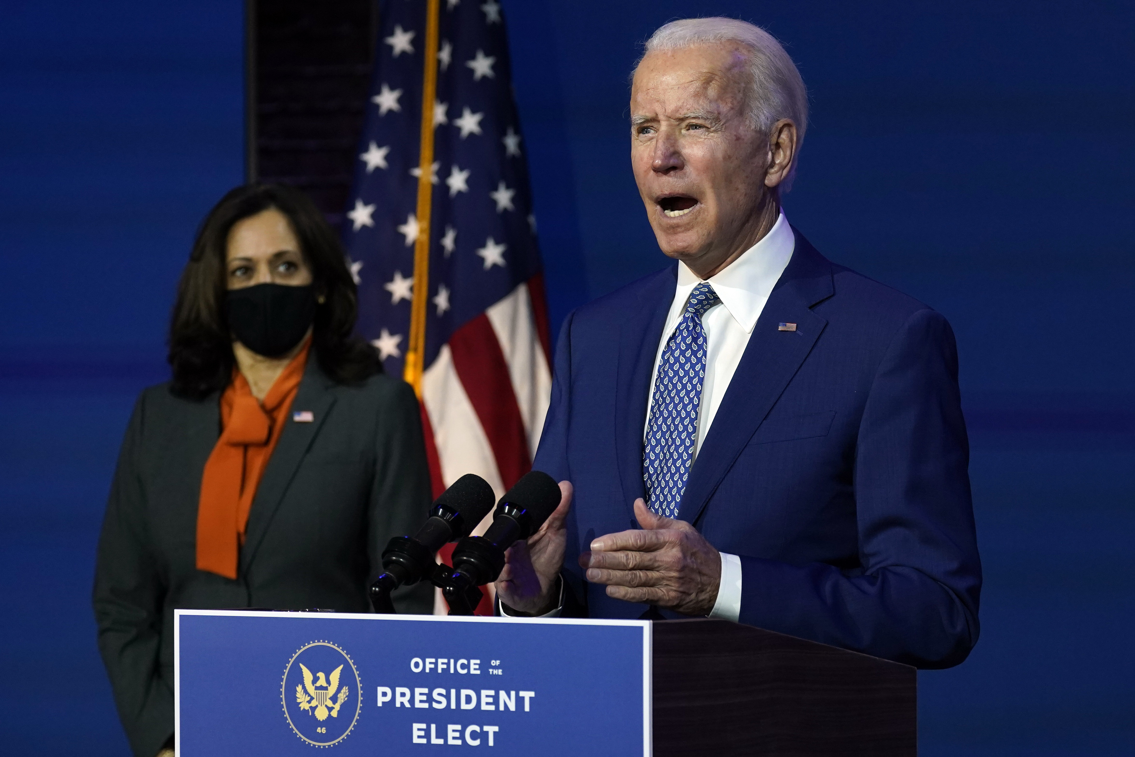 President-elect Joe Biden speaks Monday, Nov. 9, 2020, at The Queen theater in Wilmington, Del., as Vice President-elect Kamala Harris listens. Community leaders are unsure of what this administration will do to address criminal justice.