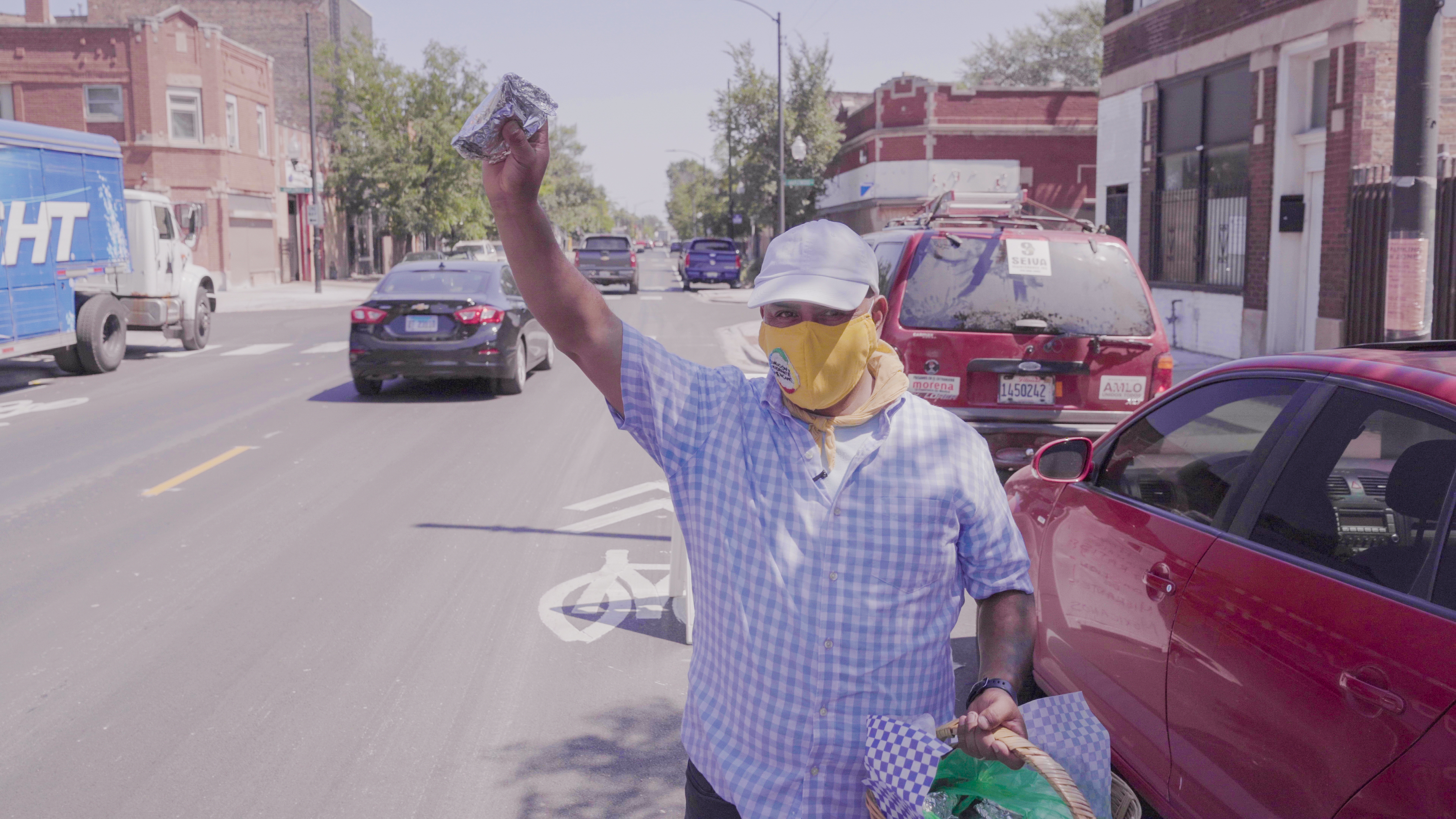 Alfonso Seiva, the president of the Coalition of Mexican Immigrants, hands out food in South Chicago in an episode of PBS/ Latino Public Broadcasting's  Latinos Are Essential.