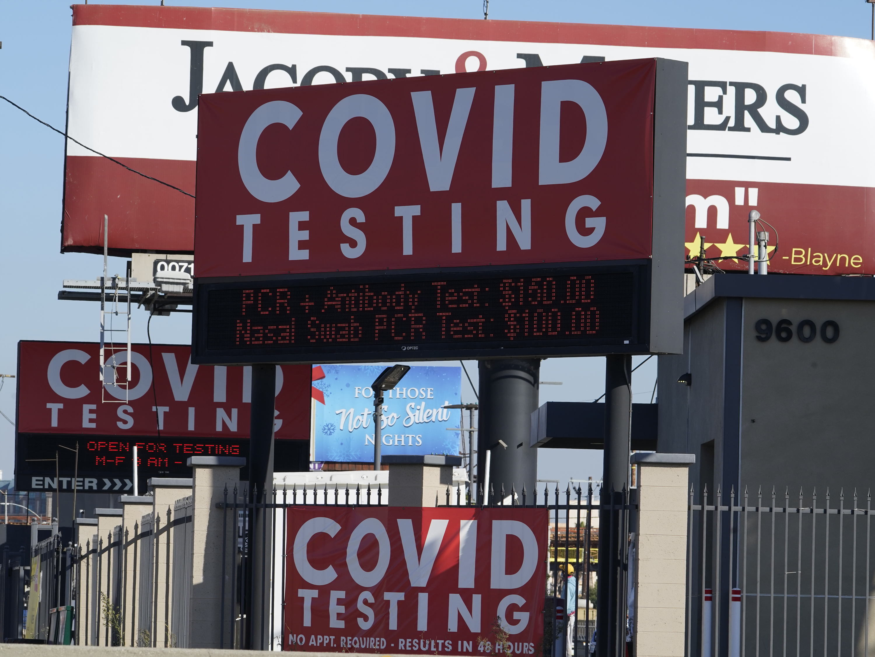 Advertisements for Covid-19 testing ares posted outside Los Angeles International Airport in Los Angeles, Friday, on Nov. 13, 2020.