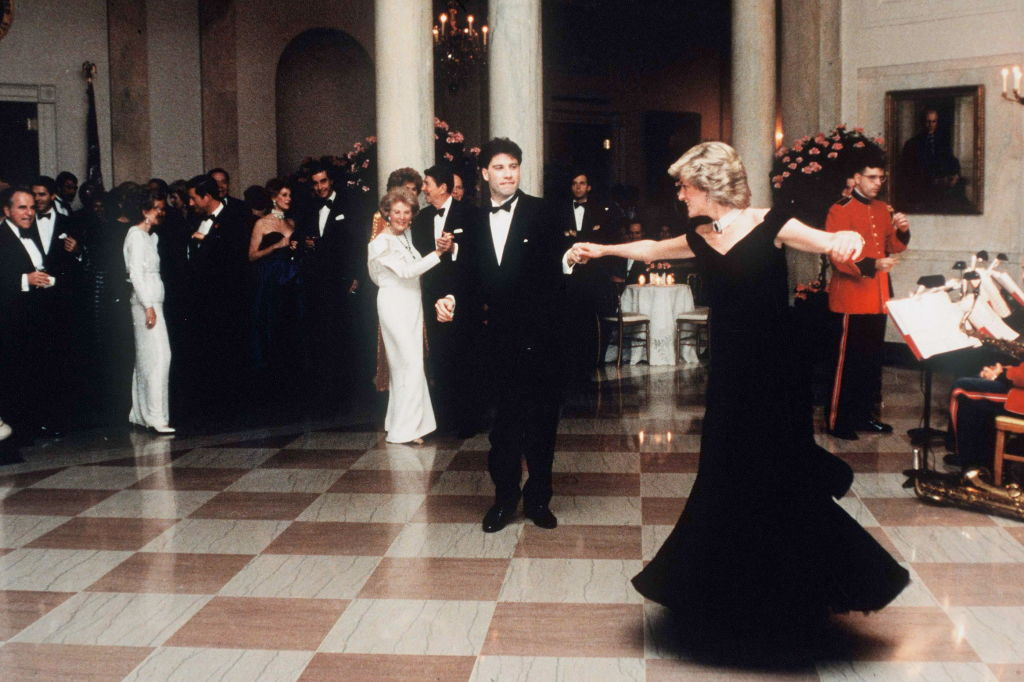 Diana, Princess Of Wales dancing with John Travolta at the White House, Washington, on Nov. 9, 1985. The princess wore a midnight blue velvet dress by fashion designer Victor Edelstein, as President Ronald and Mrs Nancy Reagan watched on