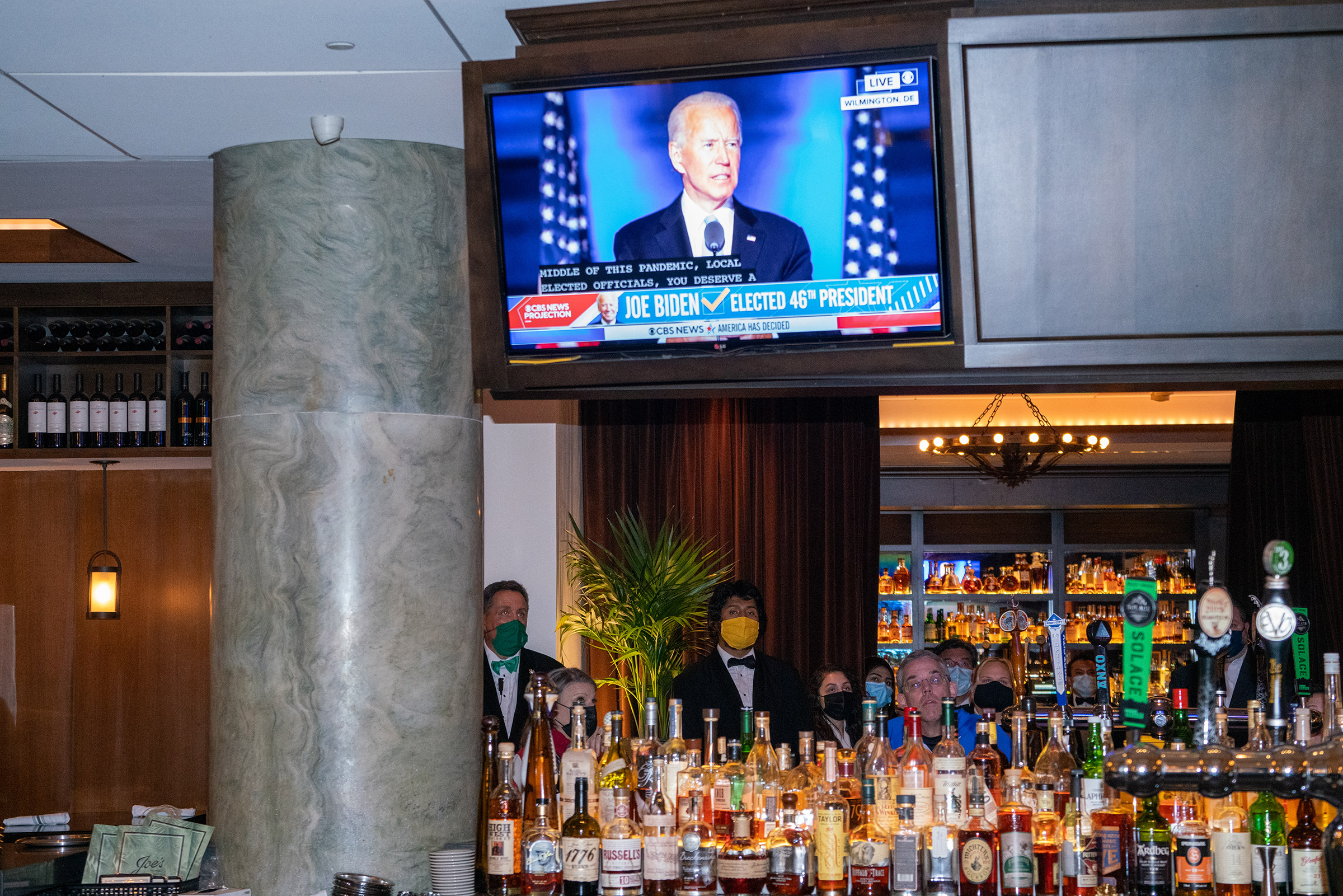 Joe Biden's first speech as President-elect is broadcast at a restaurant in Washington, D.C., on Nov. 7.