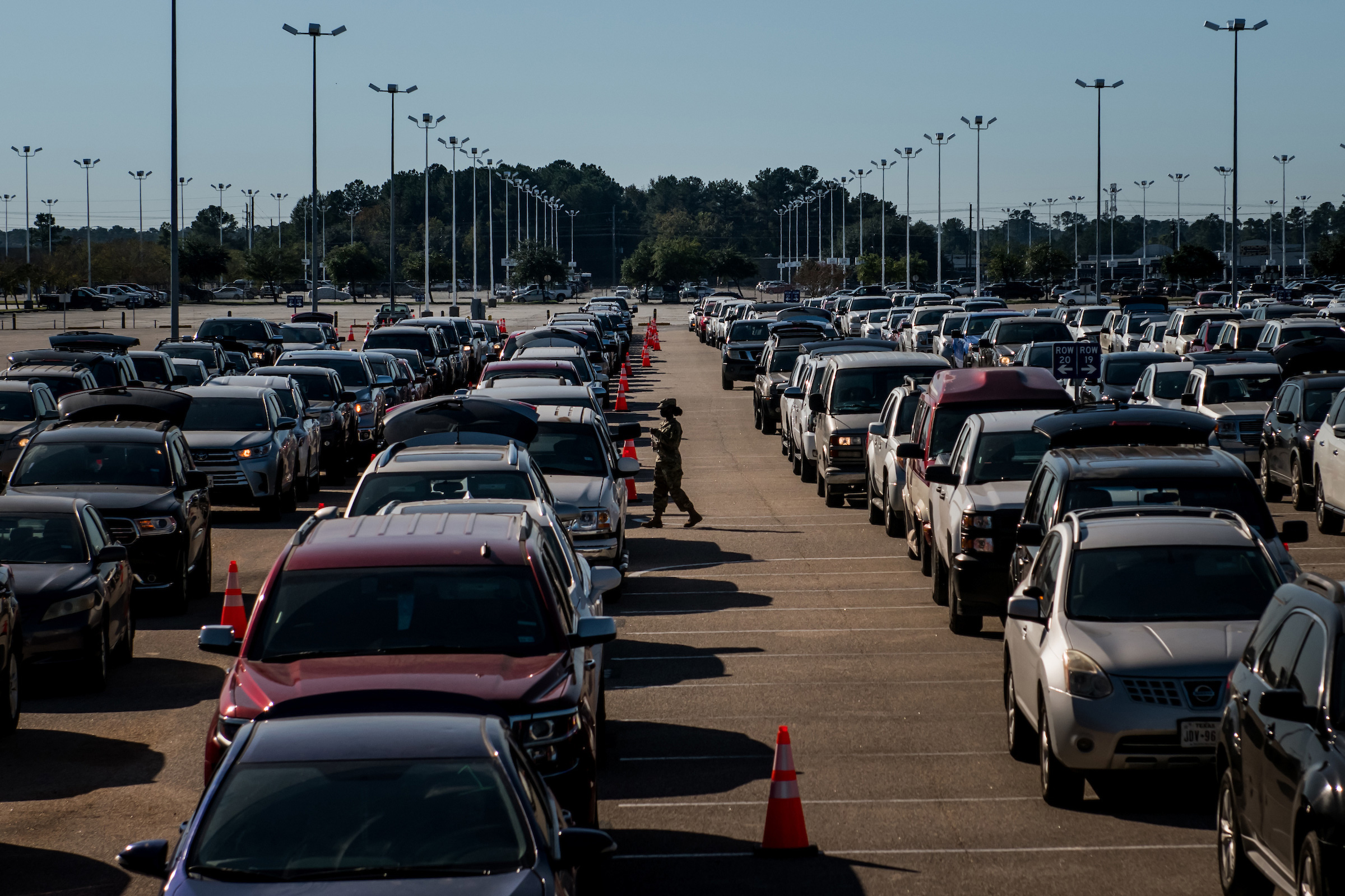 A week before Thanksgiving, cars line up at a food distribution site run by the Houston Food Bank in Houston on Nov. 17.