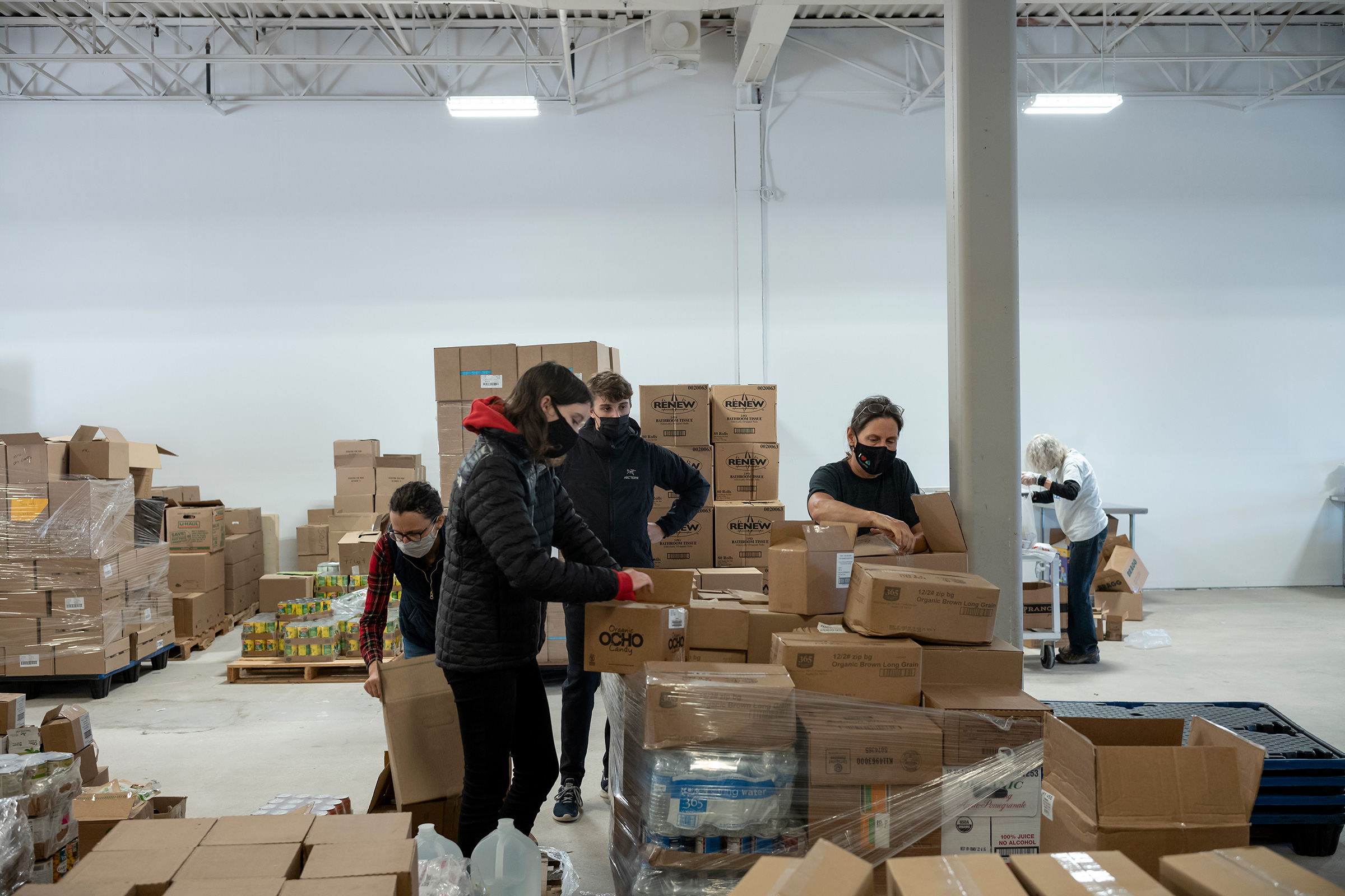 Staff and volunteers prepare food for distribution at the new CommUnity Crisis Services and Food Bank in Iowa City on Nov. 17.