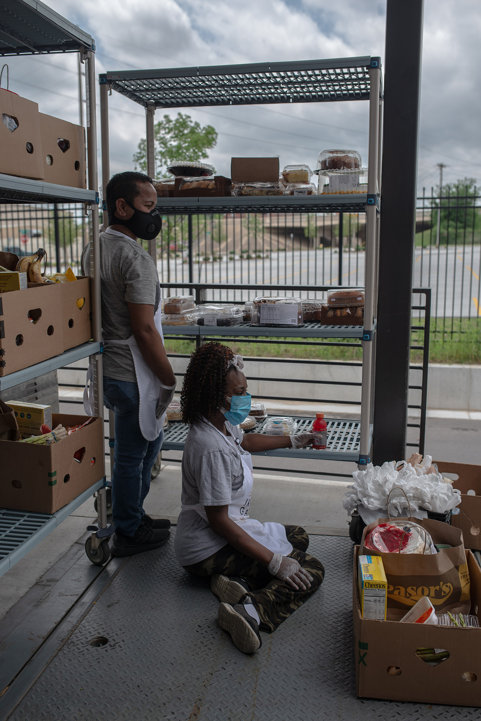 Workers at the Iron Gate drive-through food pantry in Tulsa on April 7.