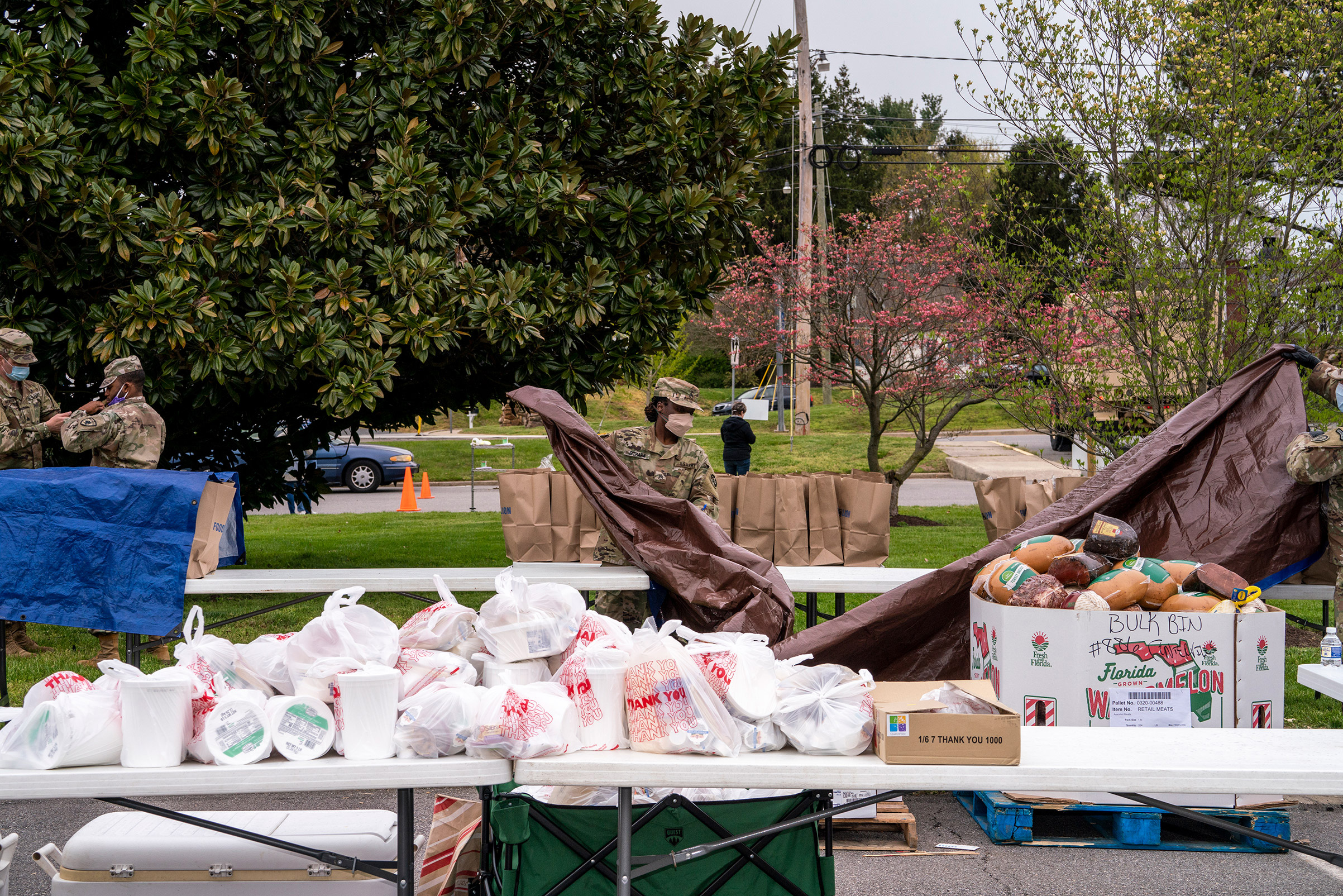 Maryland National Guard members prepare food at a distribution site in Stevensville, Md., on April 17.