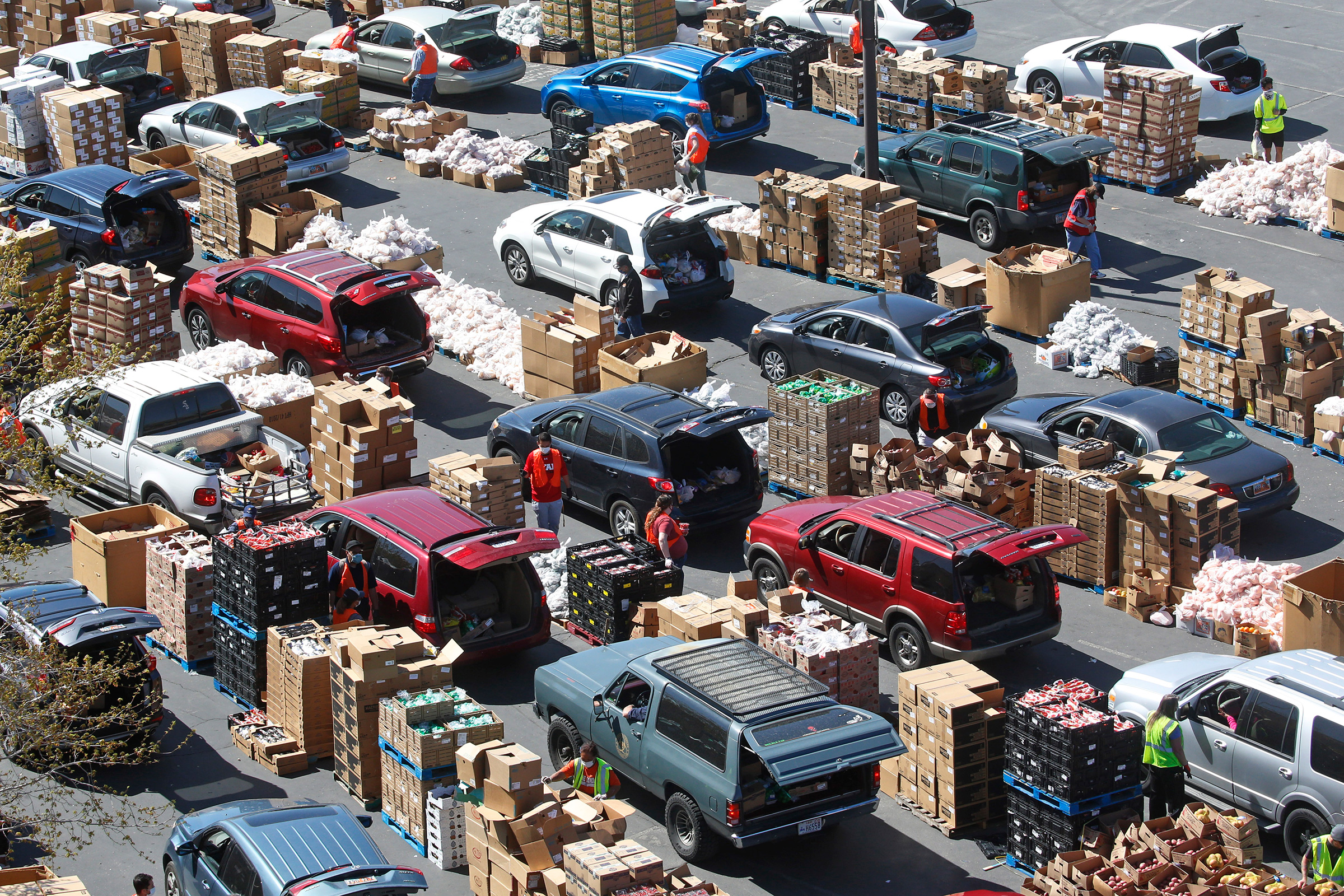 Cars line up at the Utah Food Bank's mobile food pantry in West Valley City on April 24.