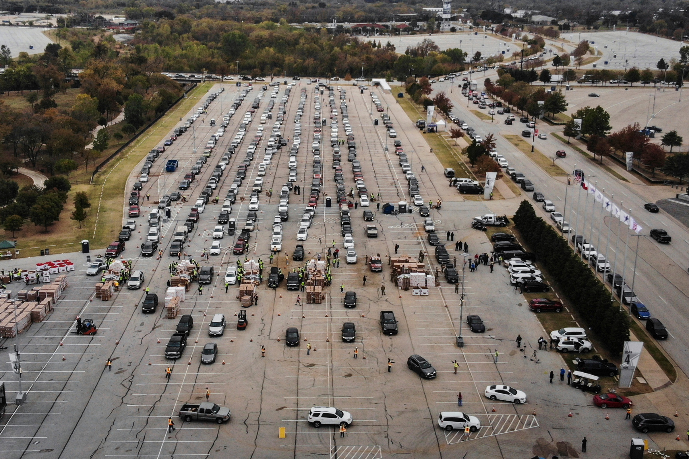 People line up in their cars to receive Thanksgiving meal boxes, which include a turkey and pantry items, from the Tarrant Area Food Bank in Arlington, Texas, on Nov. 20.