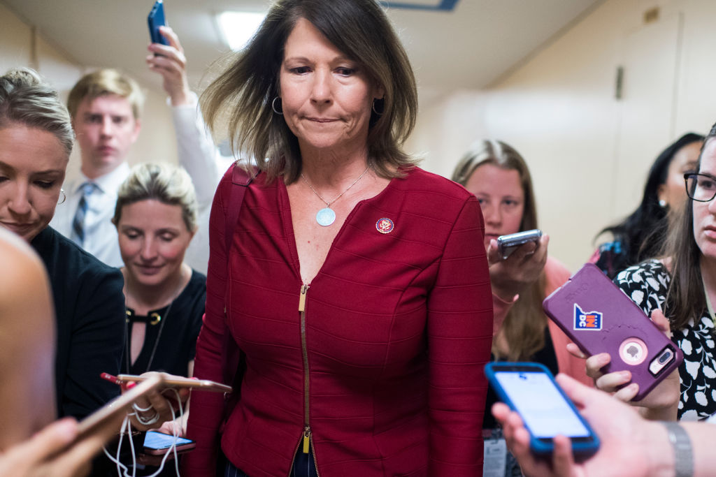 Rep. Cheri Bustos, D-Ill., talks with reporters after a meeting of the House Democratic caucus in the Capitol in Washington, DC, on July 16, 2019.