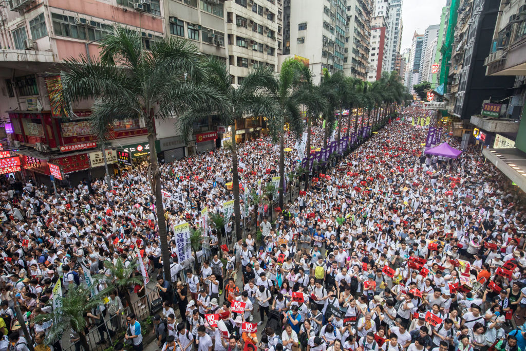 Demonstrators march during a protest against a proposed extradition law in Hong Kong, China, on Sunday, June 9, 2019.
