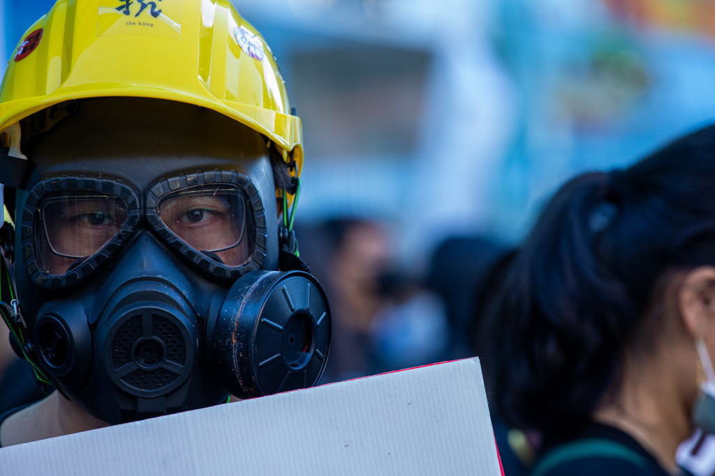 A protester wears gas mask during the march to demand the release of 12 Hong Kong detainees in Taipei, Taiwan, on October 25, 2020.
