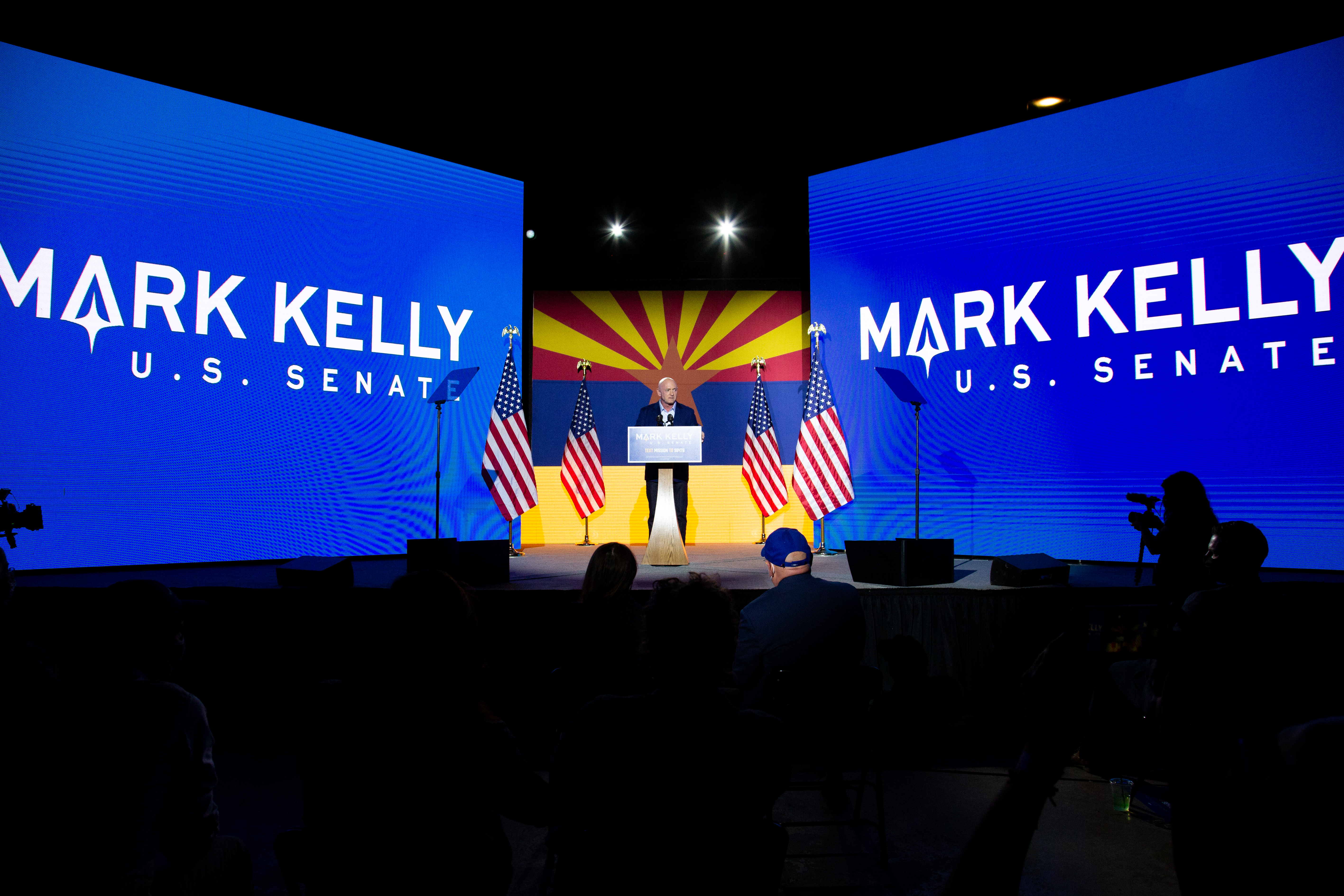 Democrat Mark Kelly speaks to supporters in Tucson, Ariz., on Nov. 3, while awaiting results of his Senate race against Republican Martha McSally.