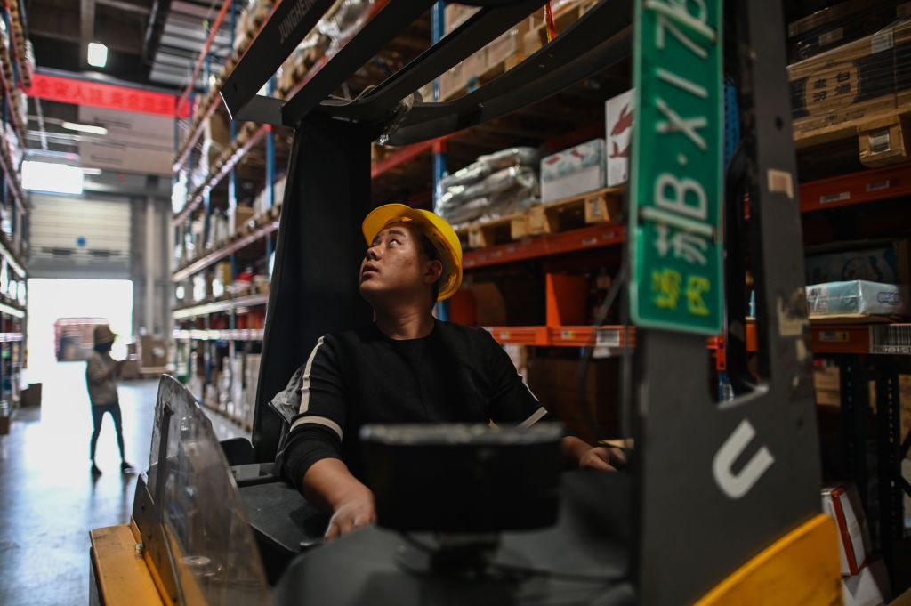 In this picture taken on November 6, 2020, an employee works in the warehouse of Cainiao Smart Logistics Network, the logistics affiliate of e-commerce giant Alibaba, in Wuxi, China's eastern Jiangsu province, ahead of Singles' Day, also known as the Double 11 shopping festival - the world's biggest shopping event - which falls on November 11.