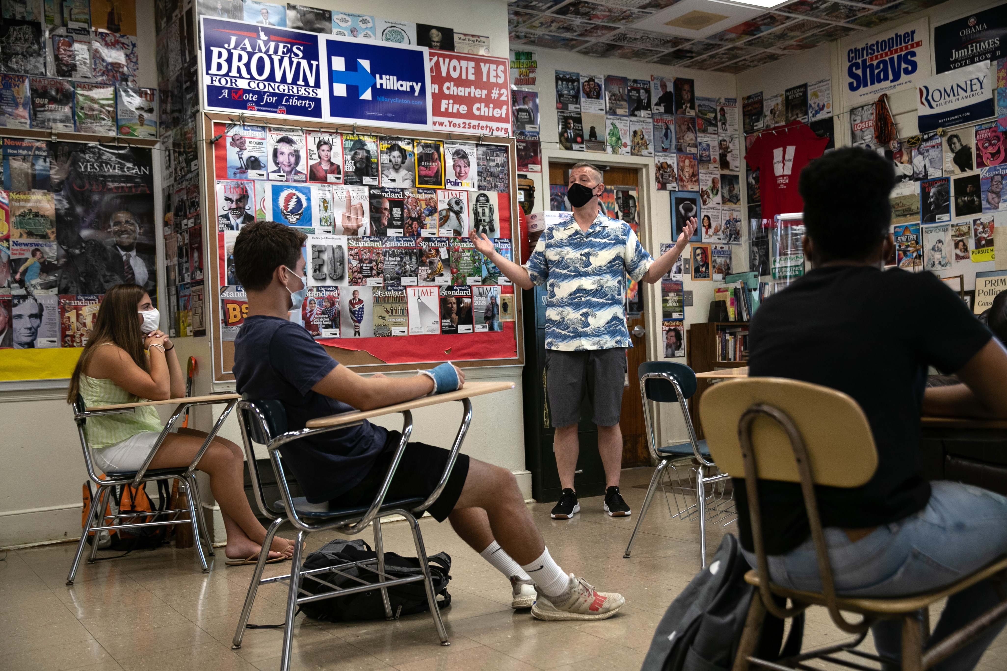 Honors civics teacher Mike Brown discusses the U.S. presidential election with masked students on the first day of school at Stamford High School on Sept. 8, 2020 in Stamford, Connecticut.