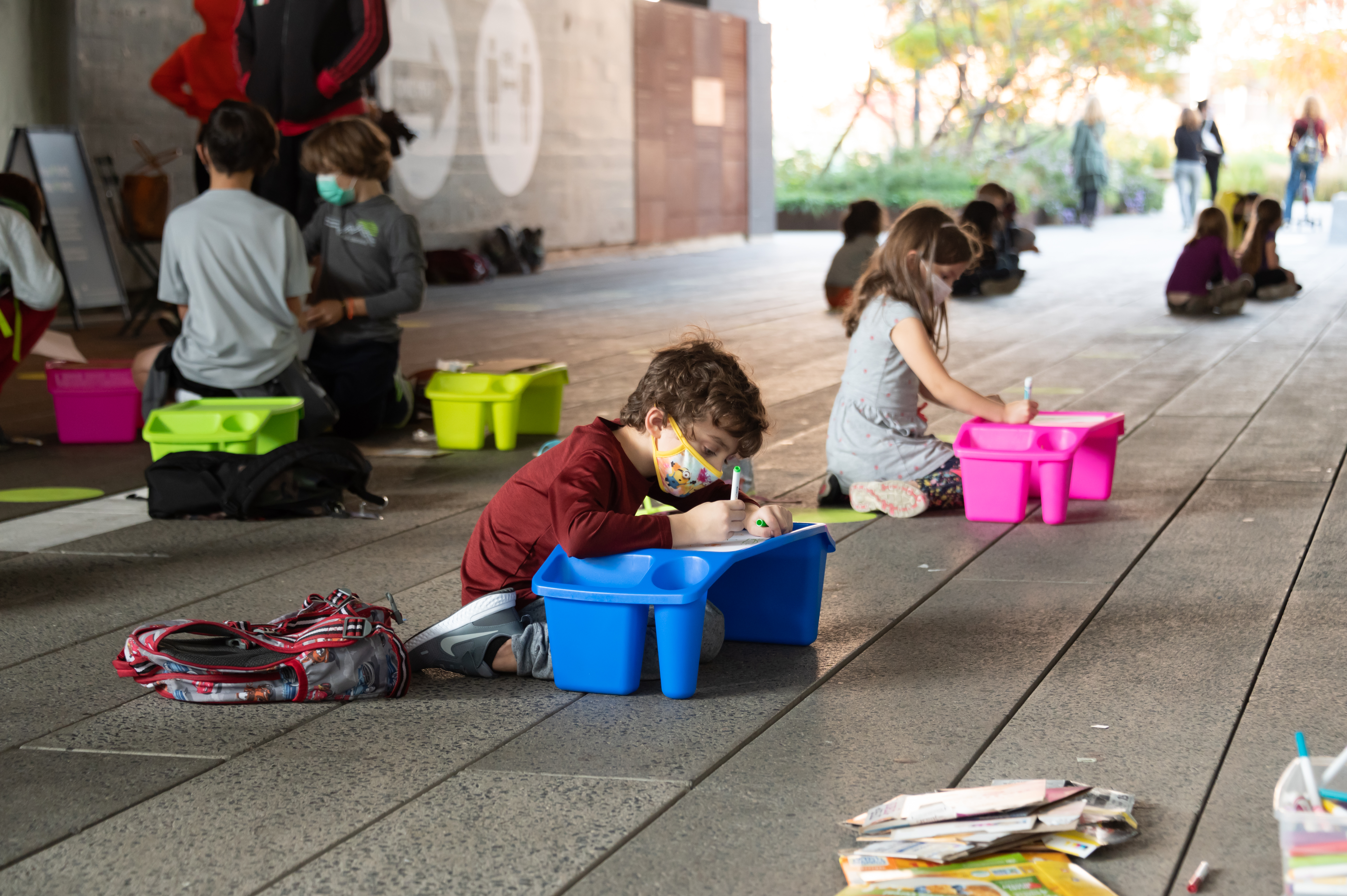 Students from PS 11 in New York City do their lessons outdoors, at the city's High Line park, on Oct. 21, 2020.