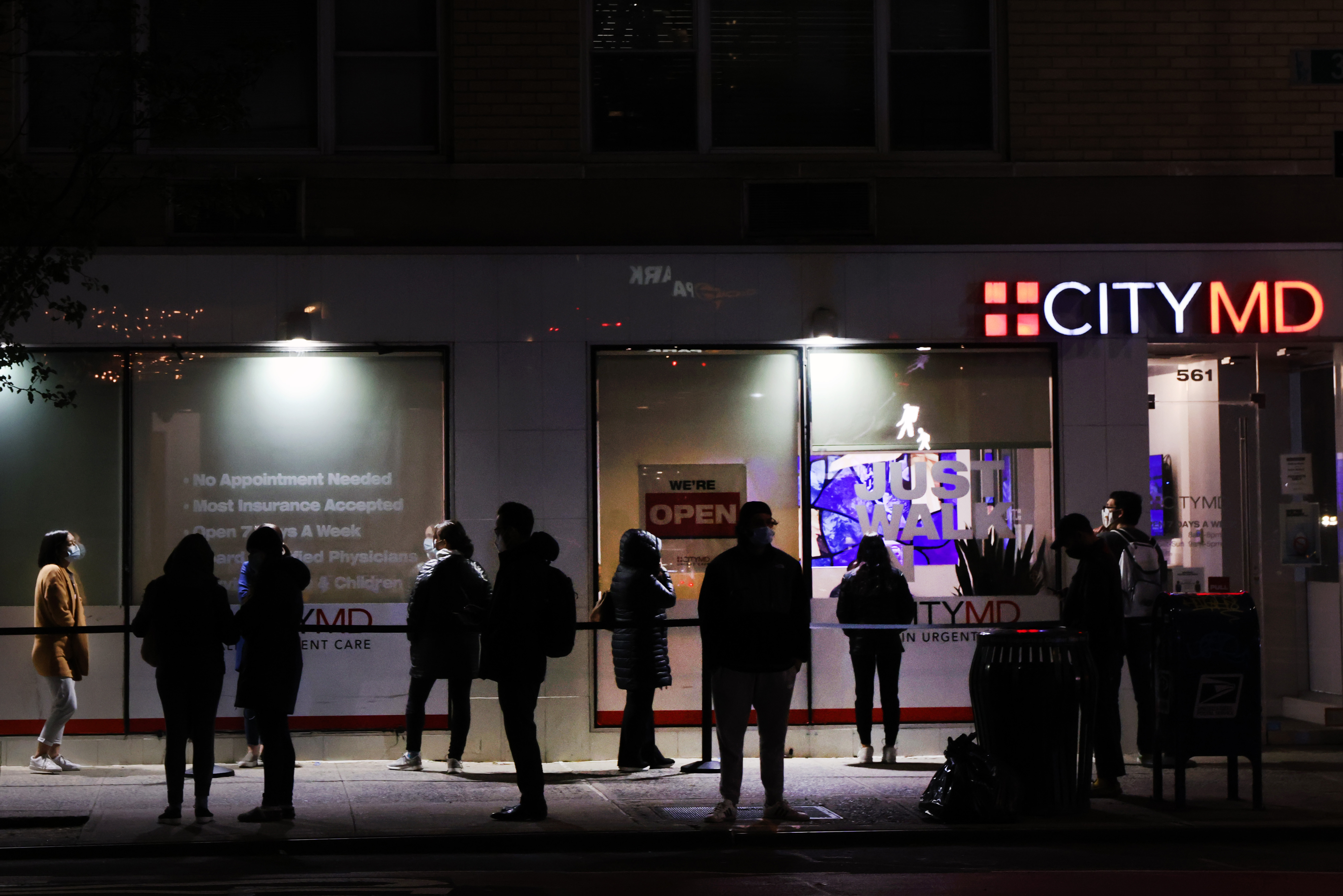 People wait in line for COVID-19 tests on Nov. 16 in New York City, where the mayor announced that rising infections were forcing schools to close down less than two months after they'd reopened for in-person learning.