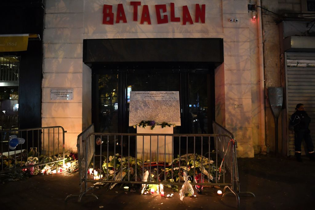 A picture taken on Nov. 13, 2017 shows lightened candles, flowers and messages at a makeshift memorial around the commemorative plaque outside the Bataclan concert hall in tribute of the victims of the attack on the Bataclan in which 90 people were killed on Nov. 13, 2015