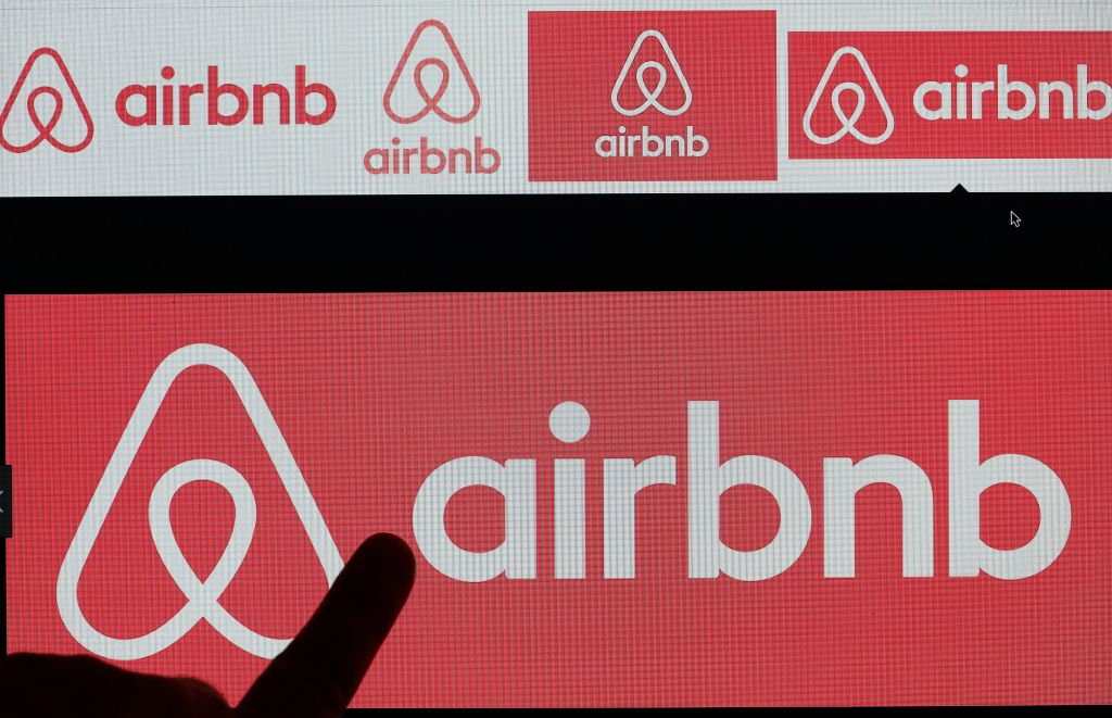 In this photo illustration, Airbnb logo is displayed on a laptop screen on December 11, 2017 in Paris, France.