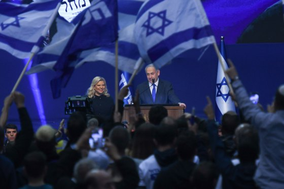 Israeli Prime Minister Benjamin Netanyahu stands next to his wife Sara as he speaks to supporters following the announcement of exit polls in Israel's election at his Likud party headquarters in Tel Aviv. on March 3, 2020.