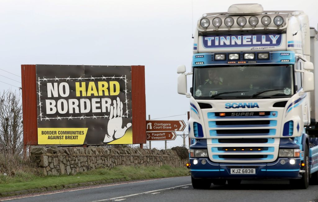 Traffic passes an 'No Hard Border' anti-Brexit, pro-Irish unity billboard poster as it crosses the border road between Newry in Northern Ireland, on February 1, 2020, in  Dundalk, Ireland.