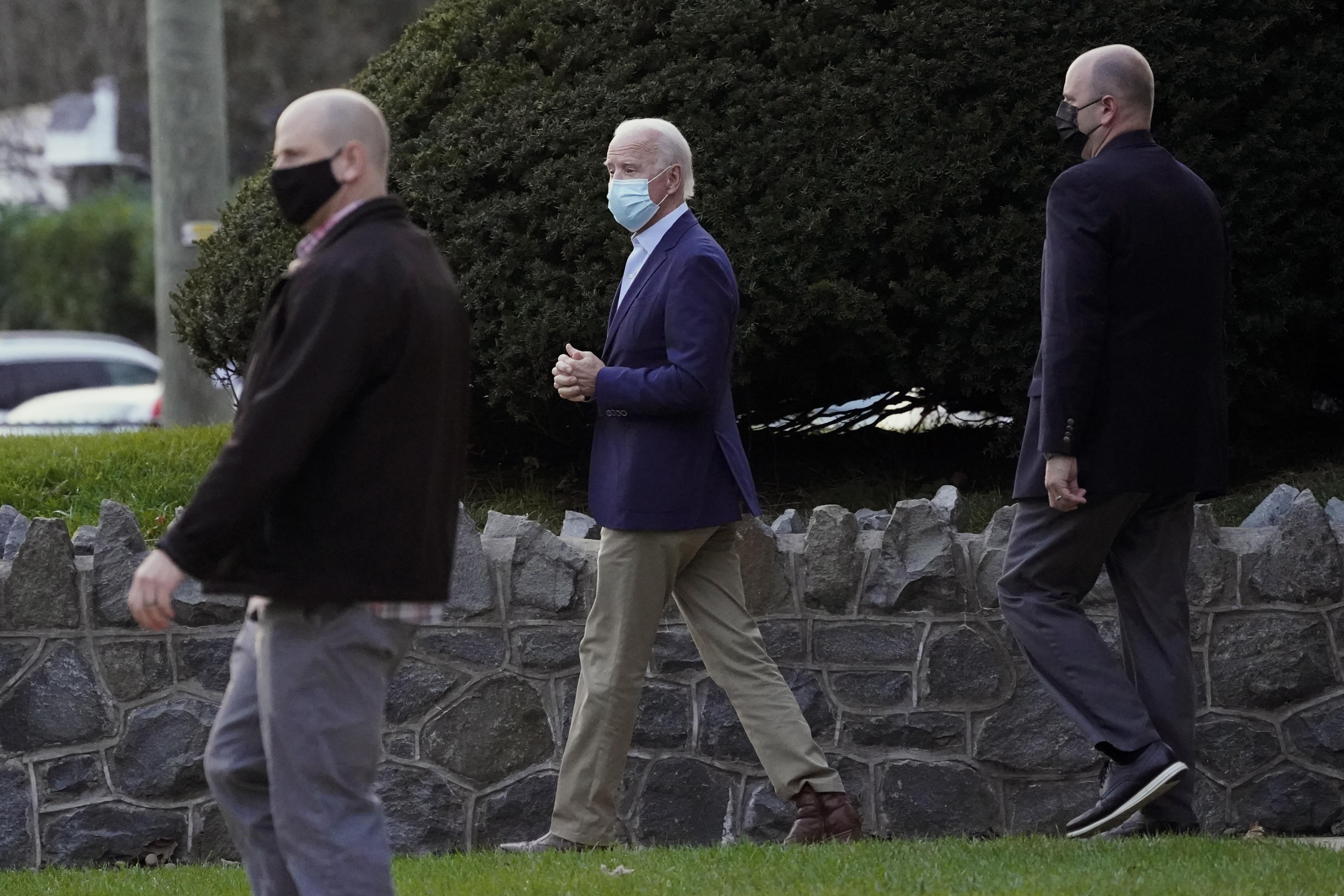 President-elect Joe Biden leaves St. Ann Parish in Wilmington, Del., on Nov. 21, 2020.
