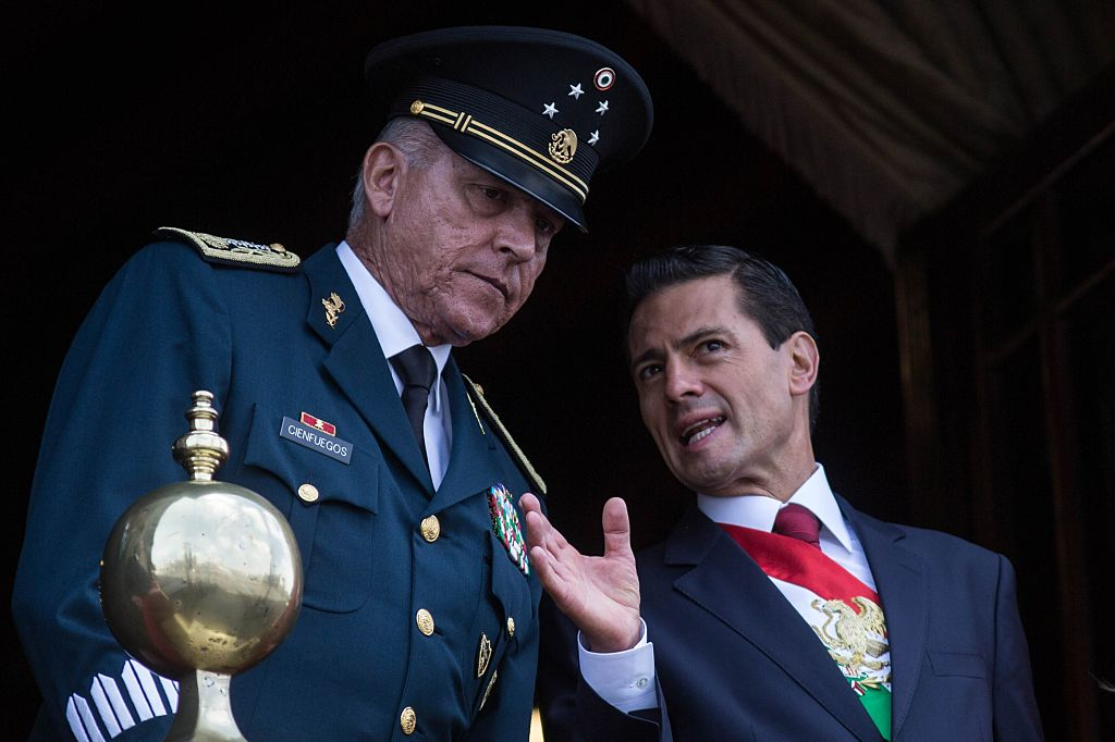 President of Mexico Enrique Pena Nieto, right, and Defense Secretary Salvador Cienfuegos Zepeda watch the annual military parade at  Zocalo main square, in Mexico City, Mexico on Sept. 16, 2016.