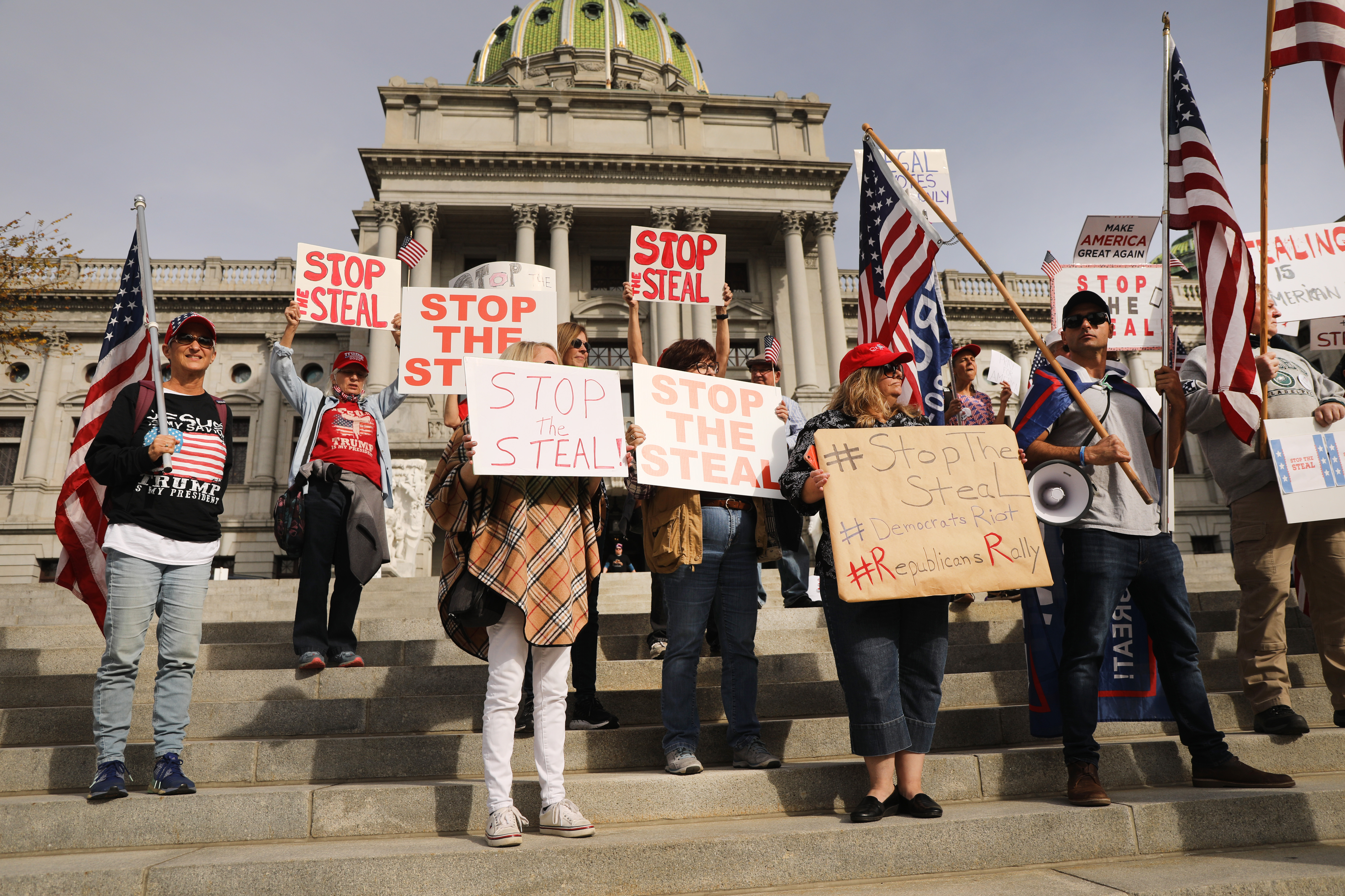 Dozens of people calling for stopping the vote count in Pennsylvania gather on the steps of the State Capital on Nov. 5 in Harrisburg, Penn. as they allege fraud against President Donald Trump.