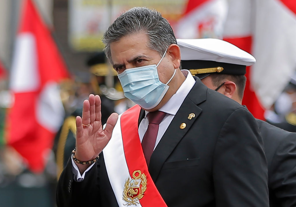 The head of the Peruvian Congress, Manuel Merino, waves after being sworn in as interim President in Lima, Peru, on November 10, 2020.