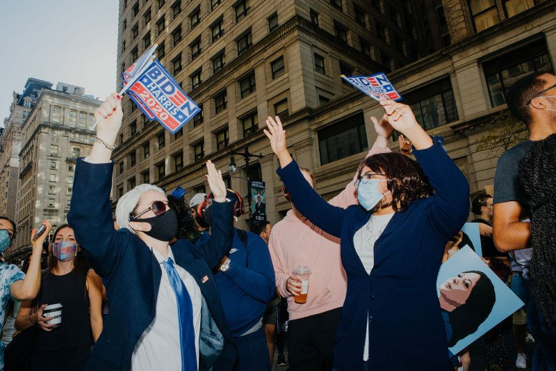 Katelyn Barbour, dressed as President-Elect Joe Biden, and Justin Procope, dressed as Vice President-Elect Kamala Harris, celebrate on Broad Street in downtown Philadelphia on Nov. 7, 2020.