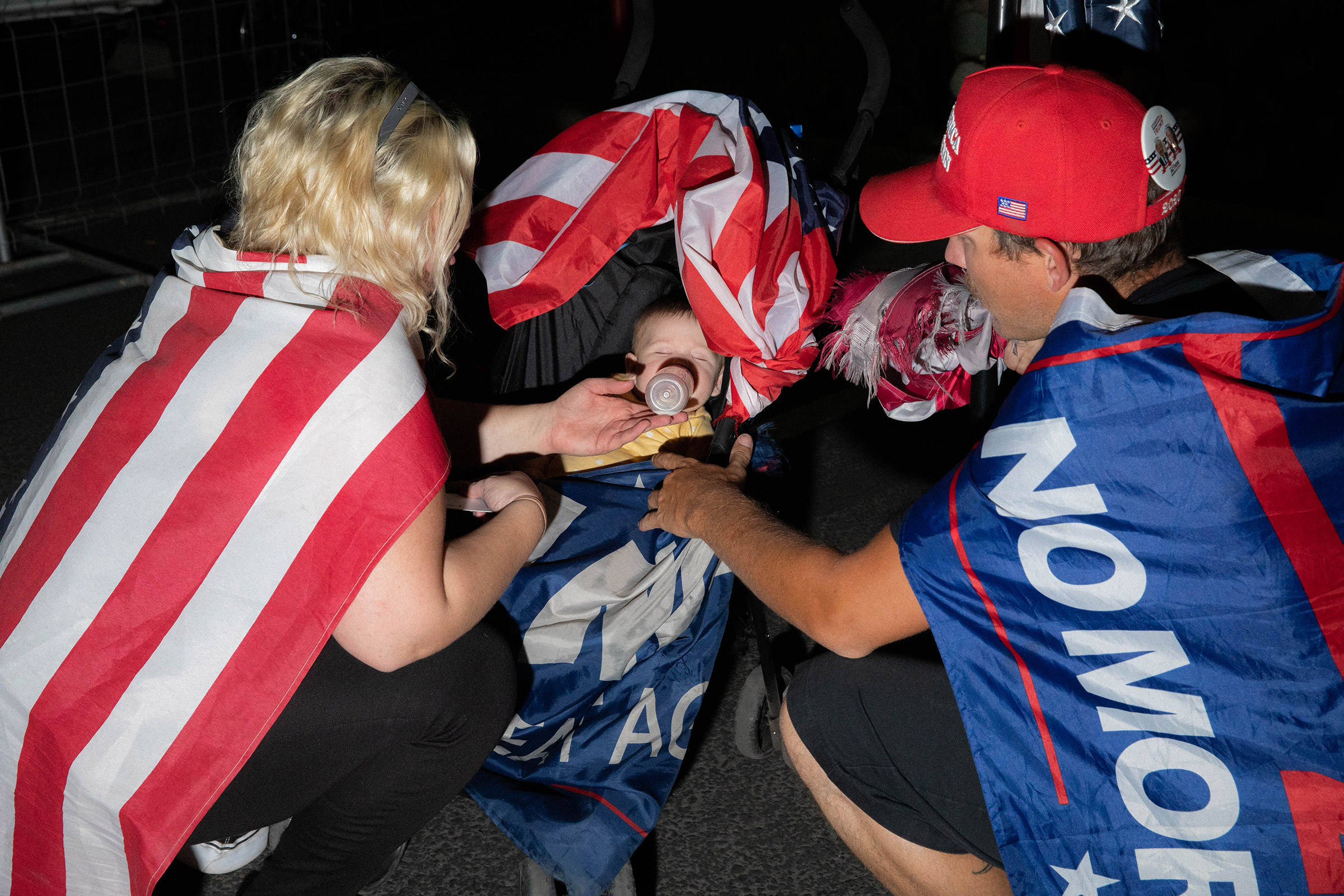 Andrew Germana and Jenna Colley feed their baby at the Maricopa County Elections office in Phoenix, on Nov. 5