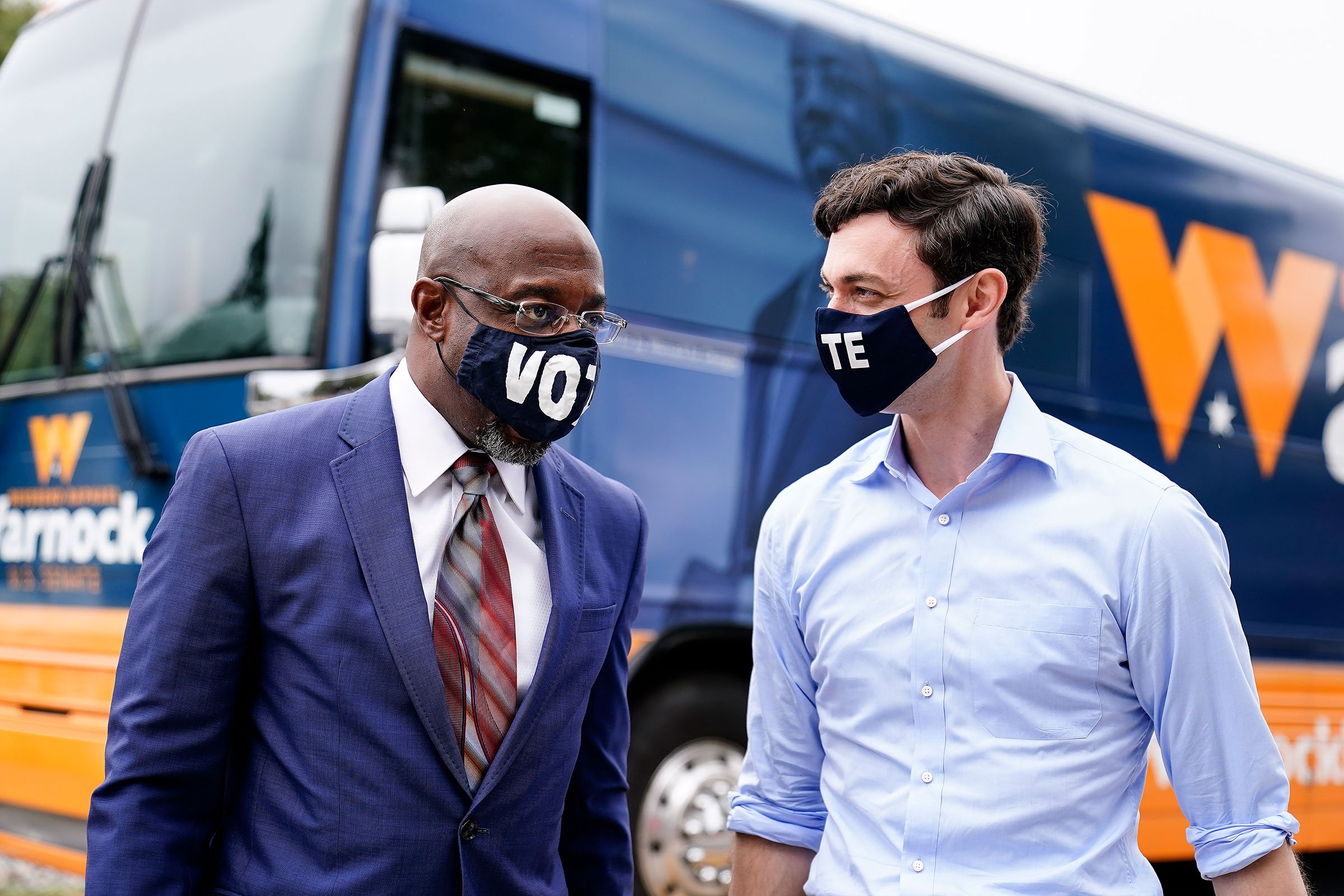 Democratic candidate for Senate Jon Ossoff, right, and Democratic candidate for Senate Raphael G. Warnock, left, arrive before they speak to a crowd during a  Get Out the Early Vote  event at in Jonesboro, Ga. on Tuesday, Oct. 27, 2020.