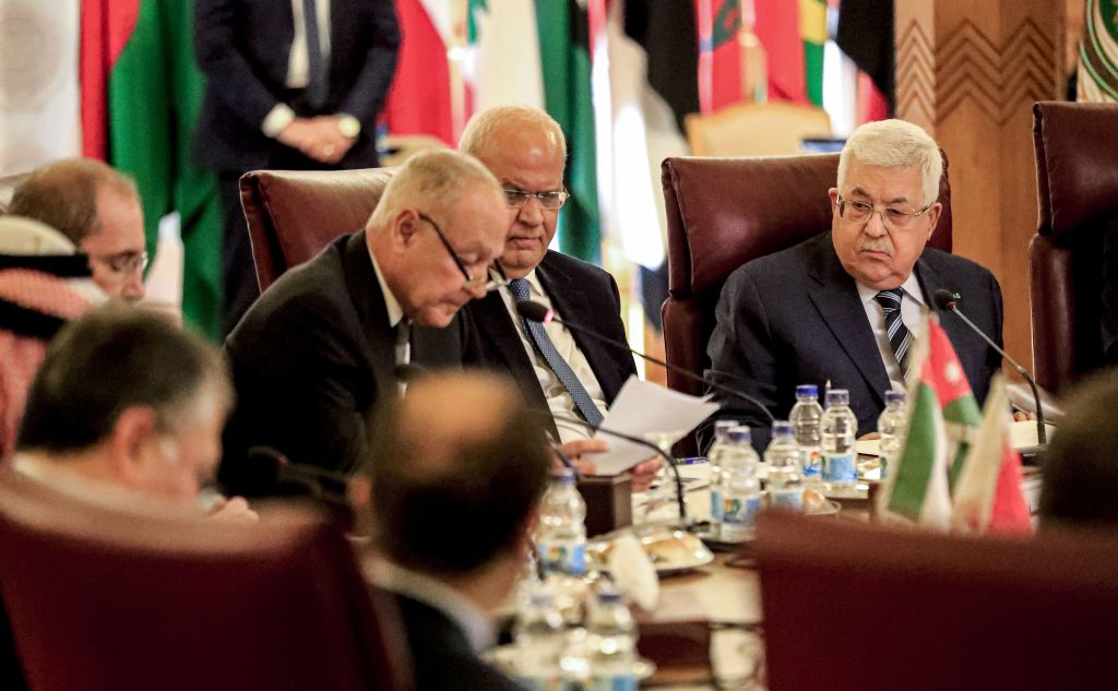 Palestinian president Mahmud Abbas (R) and Palestine Liberation Organisation (PLO) Secretary-General Saeb Erekat (C-R) look on as Arab League Secretary-General Ahmed Aboul Gheit (C) reads a statement during an Arab League emergency meeting discussing the US-brokered proposal for a settlement of the Middle East conflict, at the league headquarters in the Egyptian capital Cairo on February 1, 2020.
