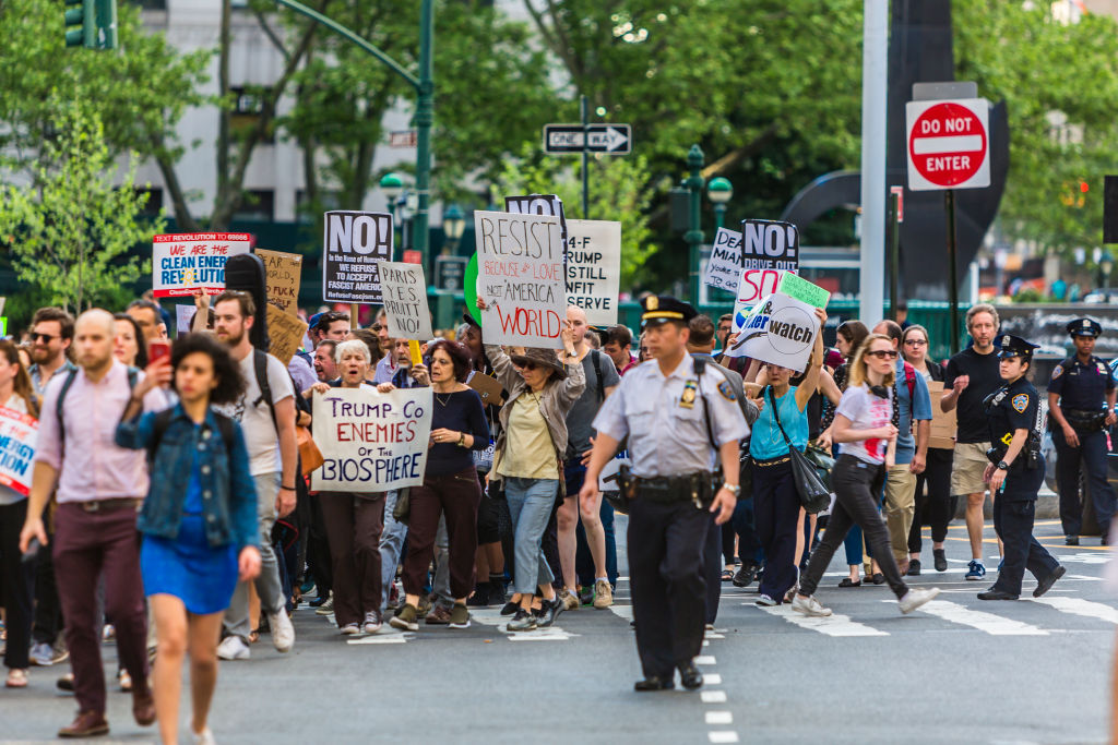 Hours after Donald Trump announced that he will withdraw the U.S. from the Paris climate agreement on June 1 2017, hundreds in New York City protested in the streets.
